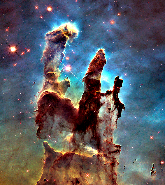 """Pillars of Creation"", a cluster of young, massive stars in a small region of the Eagle Nebula or M16, which was taken by Hubble to commemorate the upcoming 25th anniversary of the telescope. PRESS ASSOCIATION Photo. Issue date: Tuesday January 6, 2015. The Hubble telescope revisited the famous pillars, providing astronomers with a sharper and wider view of the three giant columns of cold gas bathed in the ultraviolet light. Photo credit should read: NASA/PA Wire"