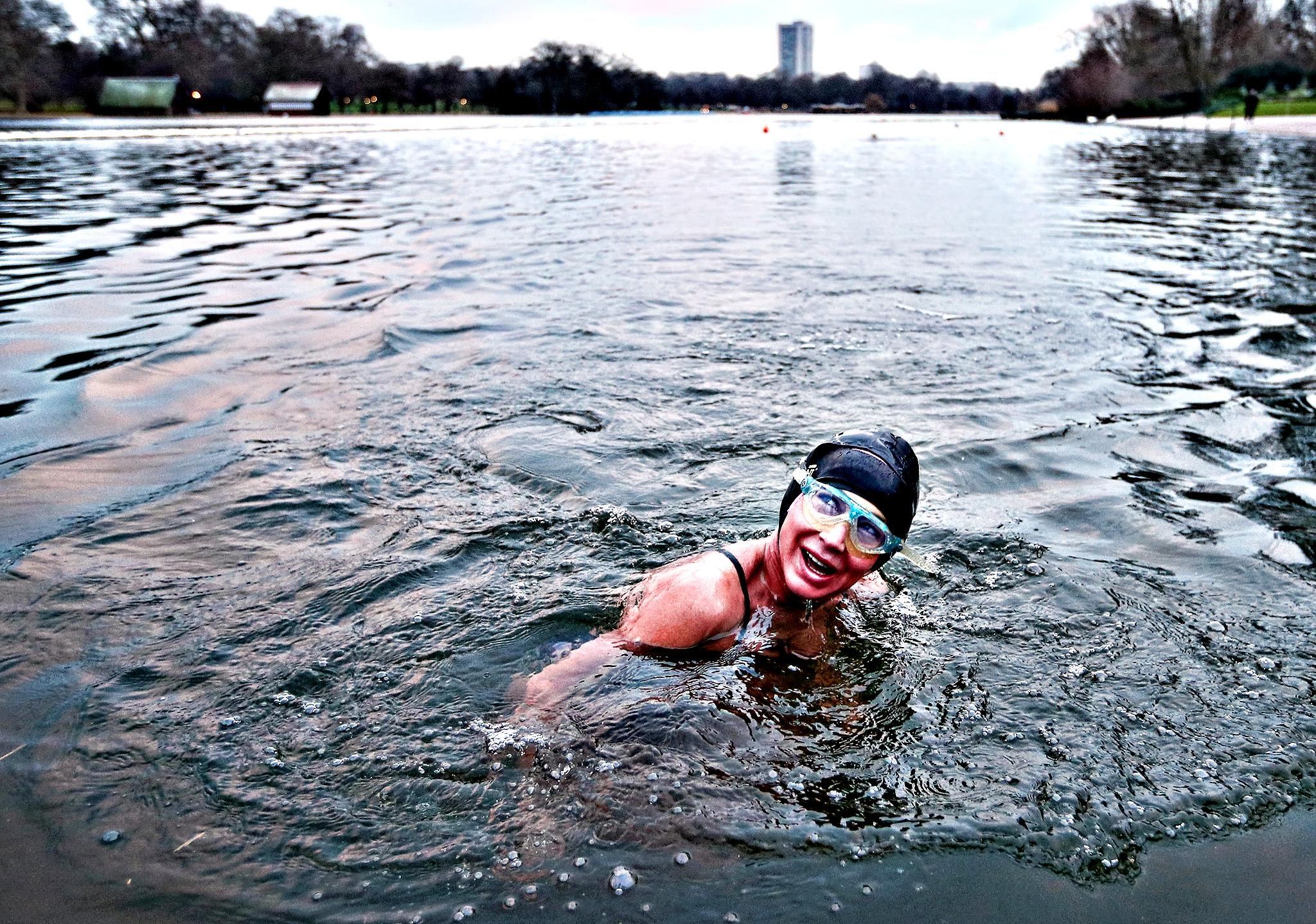 A member of the Serpentine Swimming Club enjoys an early morning swim in Serpentine Lake in Hyde Park on Monday in London, England