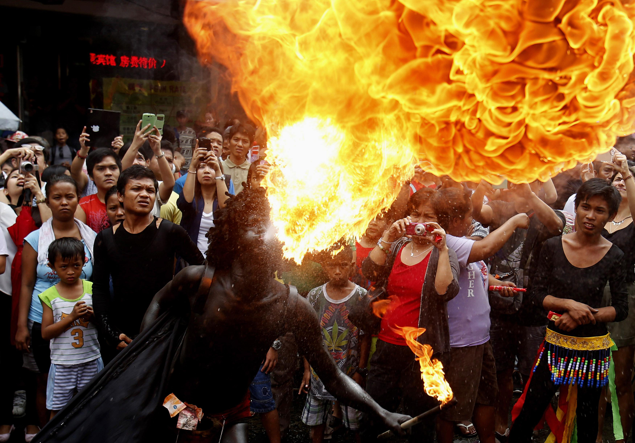 A reveller blows fire during Lunar New Year celebrations at Manila's Chinatown...A reveller blows fire during Lunar New Year celebrations at Manila's Chinatown February 19, 2015. The Chinese Lunar New Year on February 19 will welcome the Year of the Sheep (also known as the Year of the Goat or Ram).      REUTERS/Erik De Castro  (PHILIPPINES - Tags: SOCIETY)