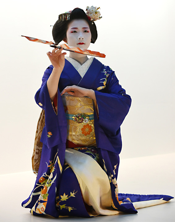 "Toshisumi, a 'Maiko,' or apprentice geis...Toshisumi, a 'Maiko,' or apprentice geisha, from Kyoto's Miyakawa cho, performs a traditional dance during the opening ceremony of the ""Kyo Aruki in Tokyo 2015,"" a Kyoto sightseeing event in Tokyo on February 4, 2015.  The 1,200-year-old city of Kyoto began a one month long campaign of events in Tokyo to attract tourists. AFP PHOTO / TOSHIFUMI"