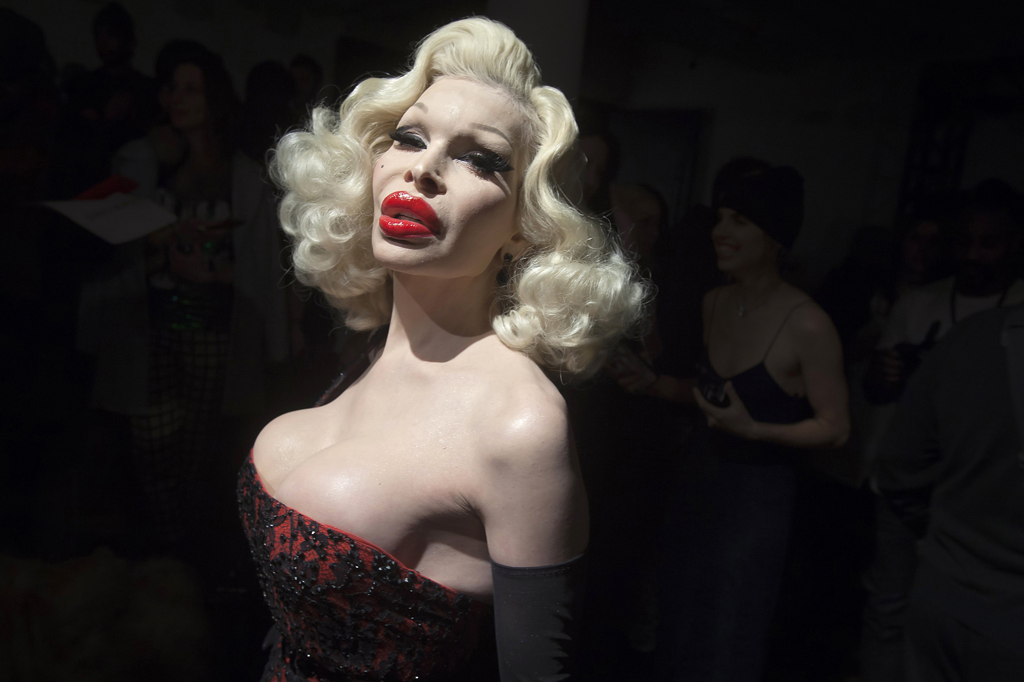 Model Amanda Lepore arrives before The Blonds 2015 collection show during New York Fashion Week...Model Amanda Lepore arrives before The Blonds 2015 collection show during New York Fashion Week in the Manhattan borough of New York February 18, 2015. Picture taken February 18, 2015.    REUTERS/Carlo Allegri   (UNITED STATES - Tags: FASHION TPX IMAGES OF THE DAY)