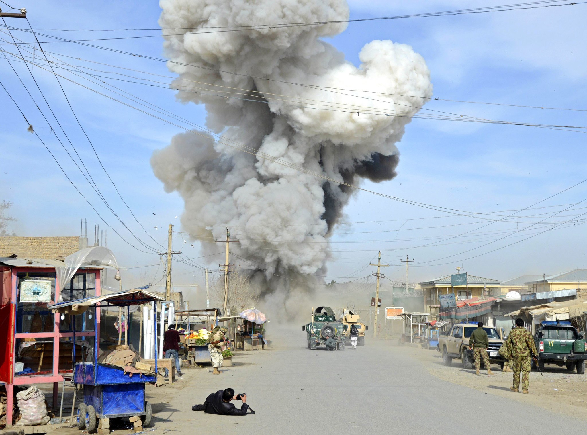 Smoke rises in the sky after a suicide car bomb attack in Kunduz province February 10, 2015. Taliban insurgents launched an attack on a police headquarters in northern Afghanistan, provincial police spokesman Sayed Sarwar Hosseini said. At least two policemen were wounded in the attack, and five suicide attackers were killed by Afghan forces, Hosseini reported.  REUTERS/Stringer (AFGHANISTAN - Tags: CIVIL UNREST TPX IMAGES OF THE DAY)