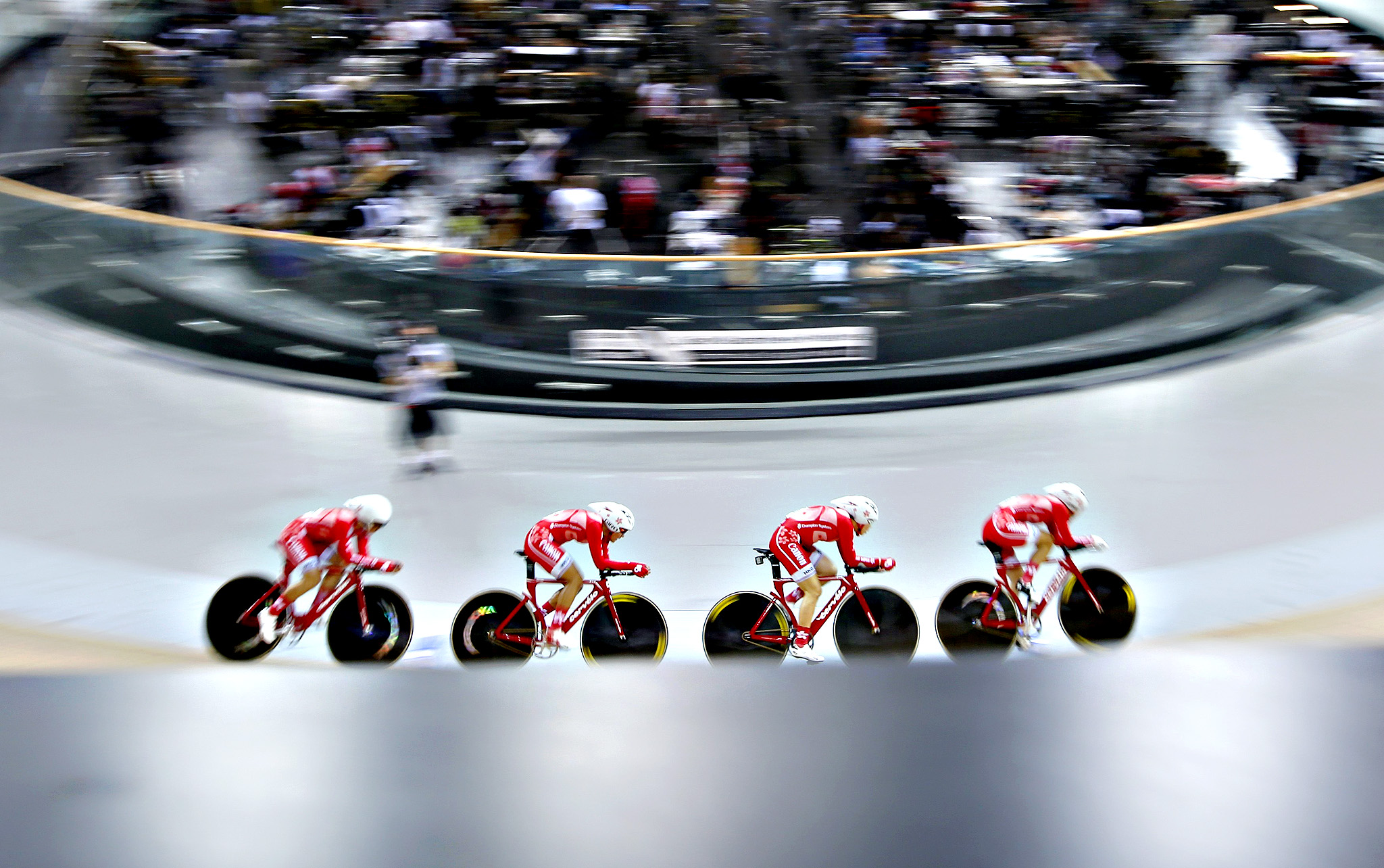 The Hong Kong team competes during the women's team pursuit qualifying race at the UCI Track Cycling World Cup in Saint-Quentin-en-Yvelines, near Paris...REFILE - CORRECTING HEADLINE  The Hong Kong team, including Pang Yao, Yang Qianyu, Leung Bo Yee and Meng Zhao Juan, competes during the women's team pursuit qualifying race at the UCI Track Cycling World Cup in Saint-Quentin-en-Yvelines, near Paris, February 18, 2015.