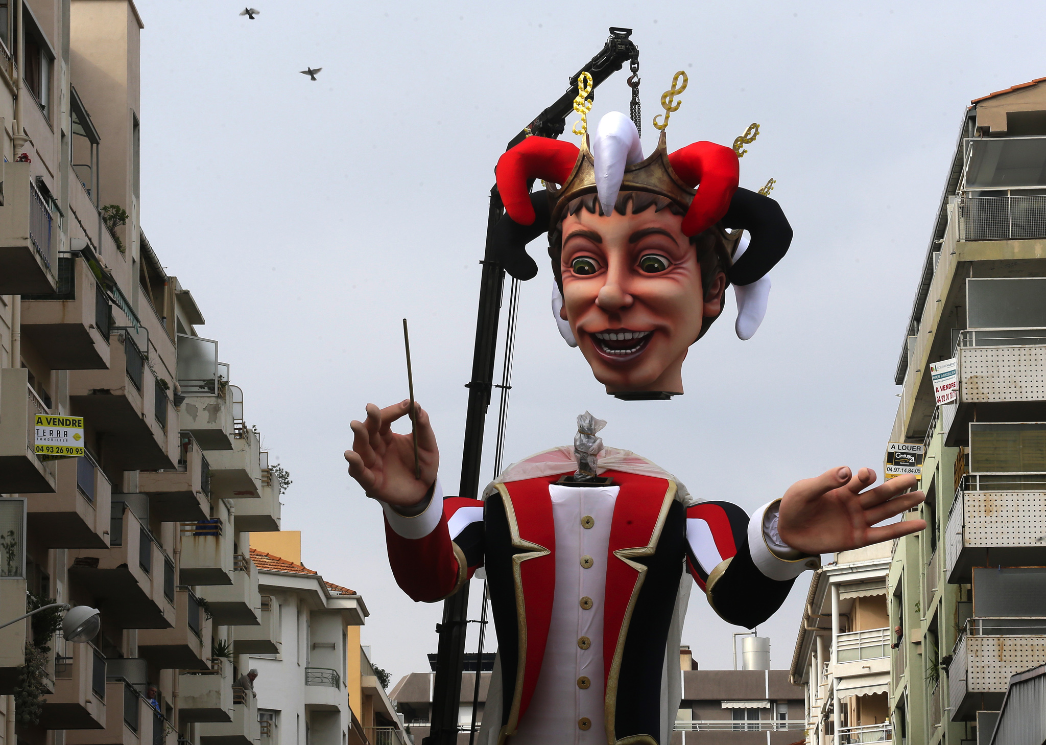 A large mannequin figure depicting the King of the Carnival is set up during preparations for the 131st Nice carnival parade in Nice, southeastern France.