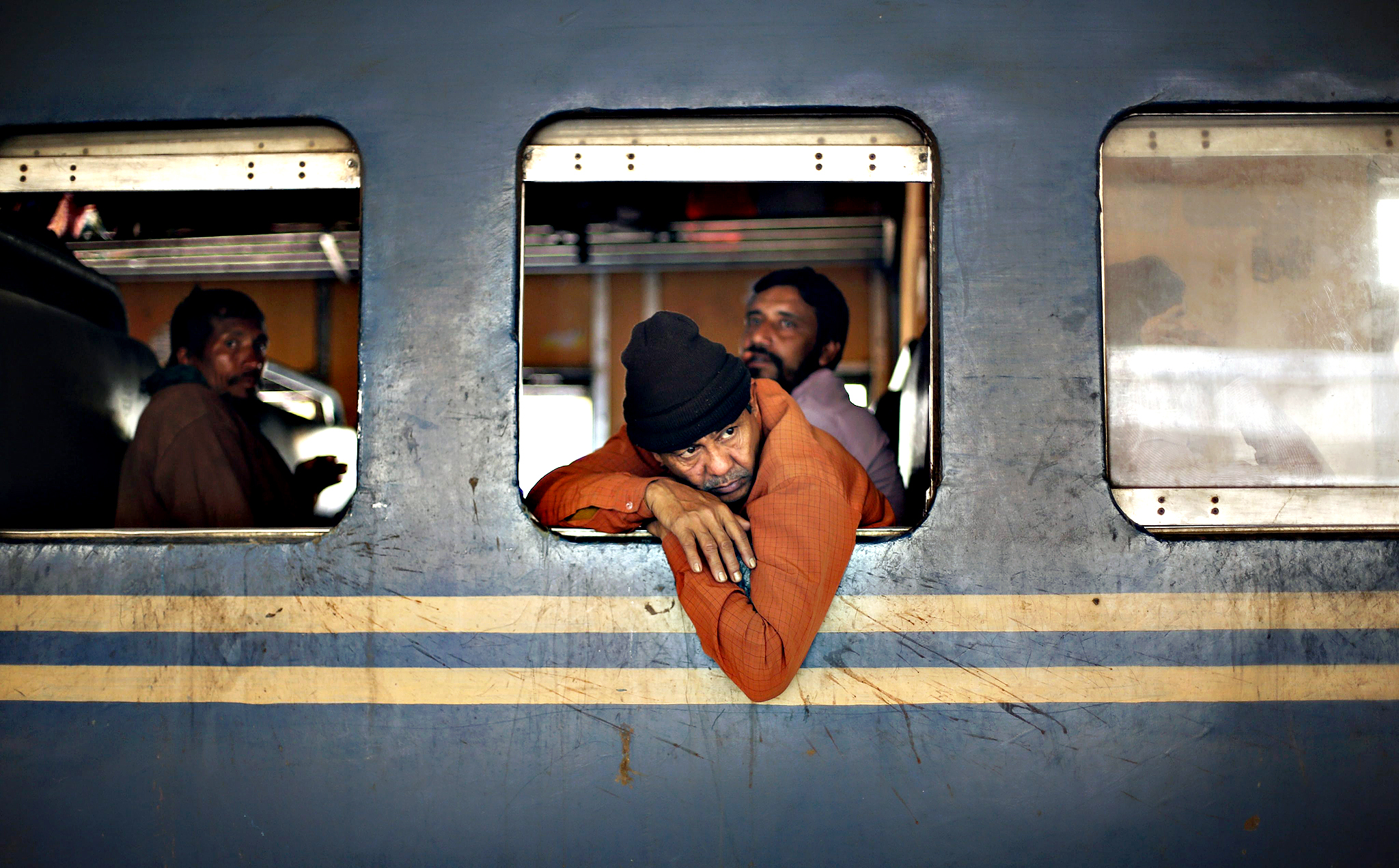 Boarded passengers wait for a train to depart during a country wide strike called by the Bangladesh Nationalist Party (BNP) in Dhaka, Bangladesh on Monday. Banglaseh economy has been suffering huge loss after the contineous blokade and strike called by BNP led 20-party for the last 27 days