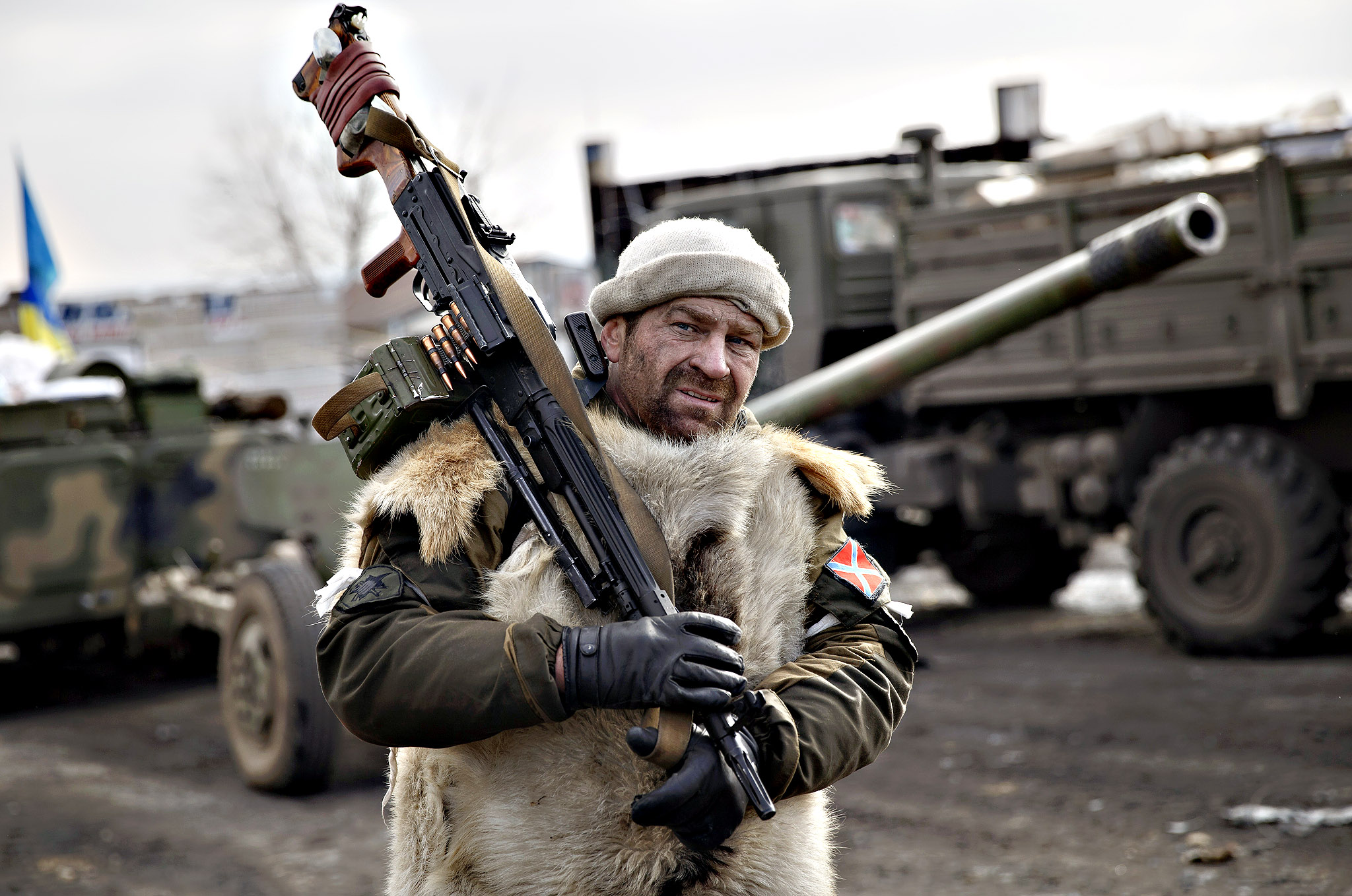 A Russia-backed rebel holds a heavy machine-gun in Debaltseve, Ukraine, Friday, Feb. 20, 2015. After weeks of relentless fighting, the embattled Ukrainian rail hub of Debaltseve fell Wednesday to Russia-backed separatists, who hoisted a flag in triumph over the town. The Ukrainian president confirmed that he had ordered troops to pull out and the rebels reported taking hundreds of soldiers captive.