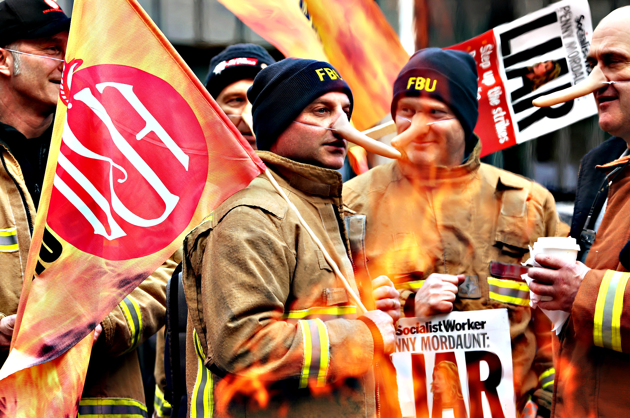 Firefighters protest during a 24 hour strike outside Methodist Central Hall Westminster on February 25, 2015 in London, England. Firefighters across the country are parcipitating in the strike over changes to their pensions.