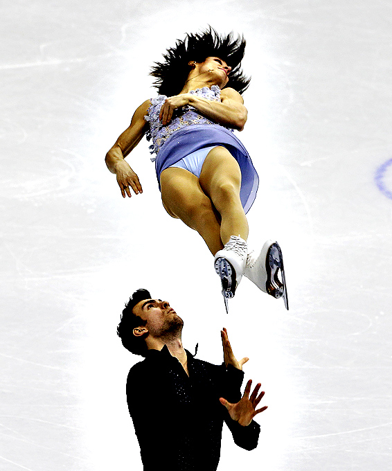 Meagan Duhamel and Eric Radford of Canada perform during the pairs short program in the ISU Four Continents Figure Skating Championships in Seoul, South Korea, Thursday, Feb. 12, 2015.
