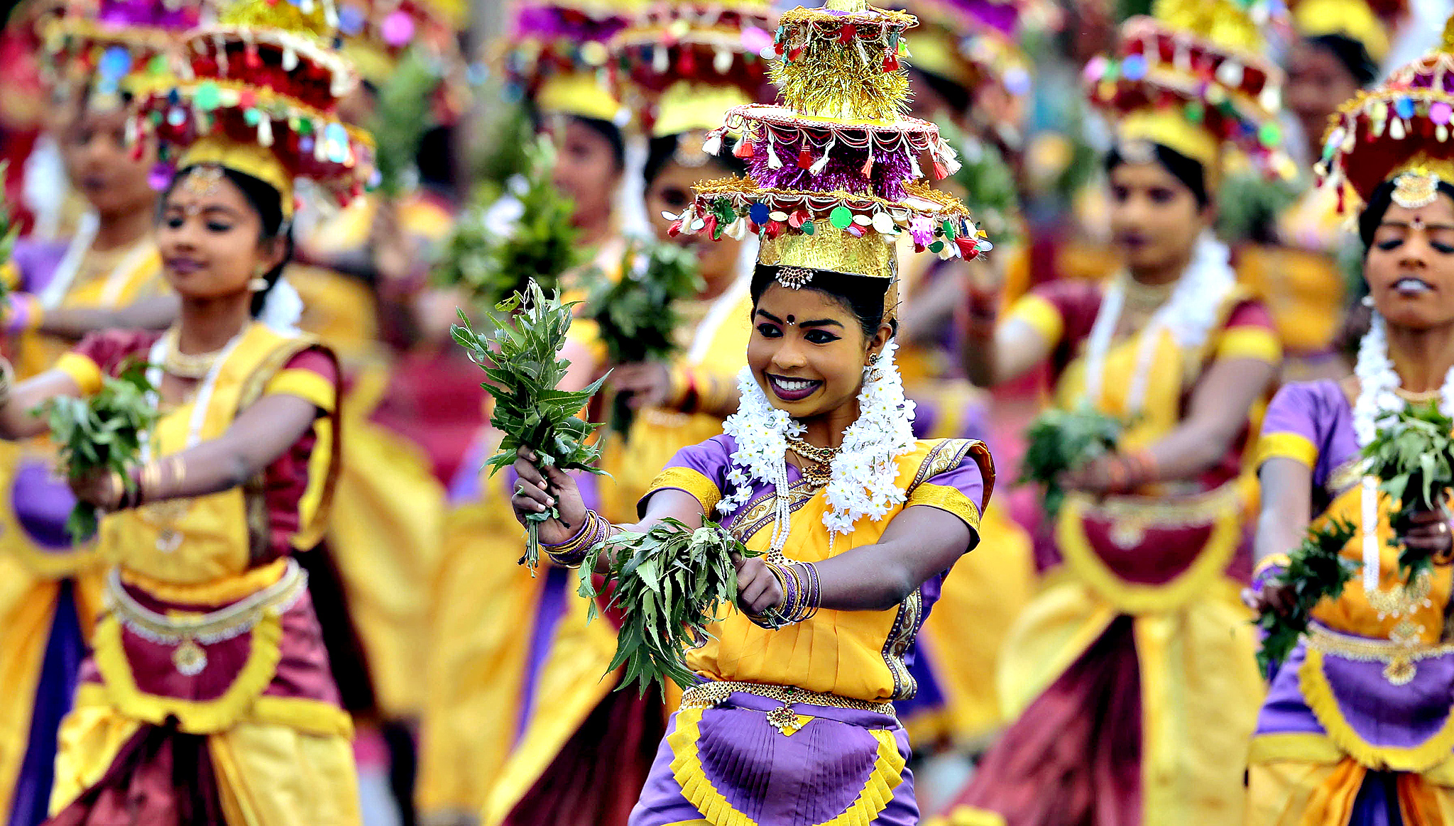 Sri Lankan ethnic Tamil dancers from northern province perform during Independence Day celebrations in Colombo, Sri Lanka, Wednesday, Feb. 4, 2015. Sri Lanka has failed to heal its deep ethnic divide since the end of the nation's civil war five years ago, the president acknowledged Wednesday in a major speech calling for national reconciliation.