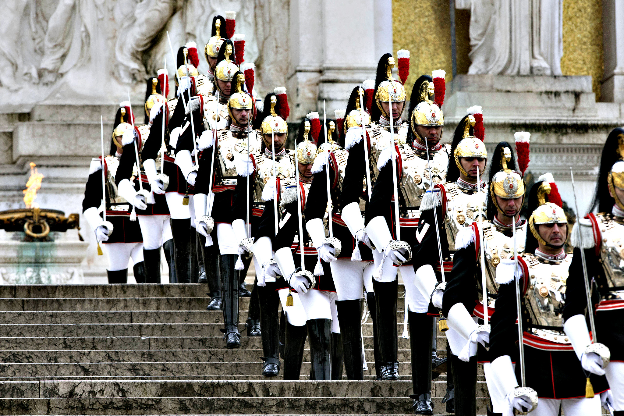 "Cuirassier presidential guards line up at the Vittoriano Unknown Soldier monument prior to the arrival of newly elected Italian President Sergio Mattarella in Rome, Tuesday, Feb. 3, 2015. Italy's new president, Sergio Mattarella, has taken the oath of office with a vow to fight corruption and organized crime and encourage the nation to embrace economic and electoral reform. The new head of state, whose brother, Piersanti Mattarella, was slain while governor of Sicily by the Mafia in 1980, denounced as ""alarming"" the spread of the Mafia from its traditional base in the south to northern cities. Mattarella, in his speech to Parliament Tuesday, also decried pervasive corruption, which he said robs citizens of resources meant for them and upsets market rules, ""penalizing the honest and the capable."""
