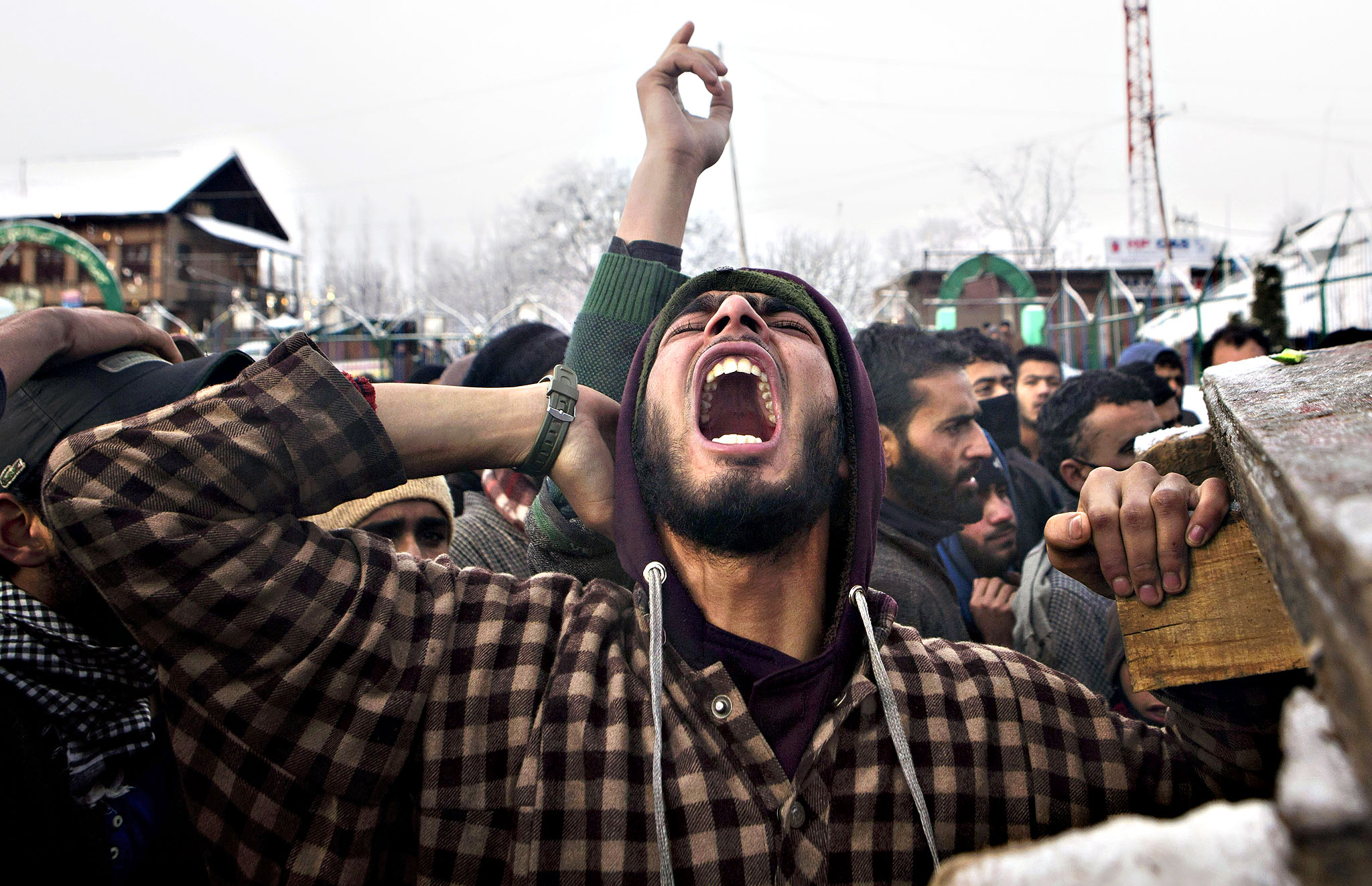 A Kashmiri Muslim villager shouts pro freedom slogans during the funeral procession of Shabir Ahmed Gania, a suspected local militant of Hizbul Mujahideen outfit, in Drubgham, some 55 kilometers (33 miles) south of Srinagar, India, Thursday, Feb. 26, 2015. Thousands attended the funeral of two suspected militants killed in a fierce gunbattle Wednesday in a southern village of the disputed Himalayan region of Kashmir, according to local reports.