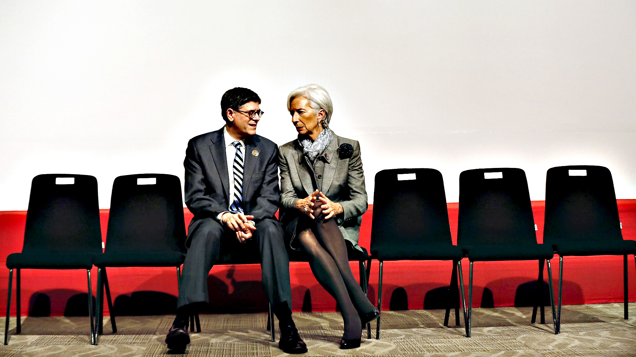 Managing Director of the International Monetary Fund Christine Lagarde chats with US Treasury Secretary Jack Lew after the family photo during the G20 meeting of Finance Ministers and Central Bank Governor at the finance ministry in Istanbul, Turkey, 10 February 2015.