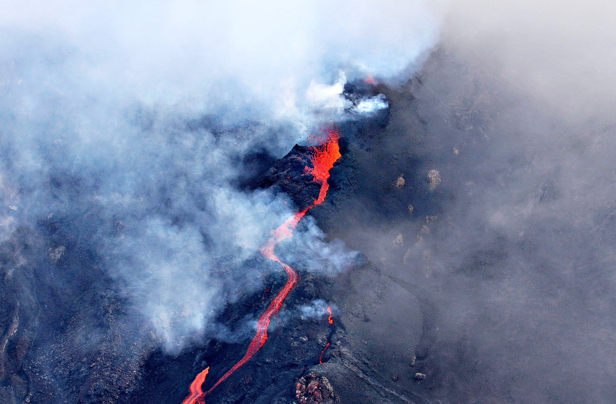Reunion Island's active volcano, the Piton de la Fournaise, erupting near the Dolomieu, Bory and Rivals craters on the French Island of Reunion.