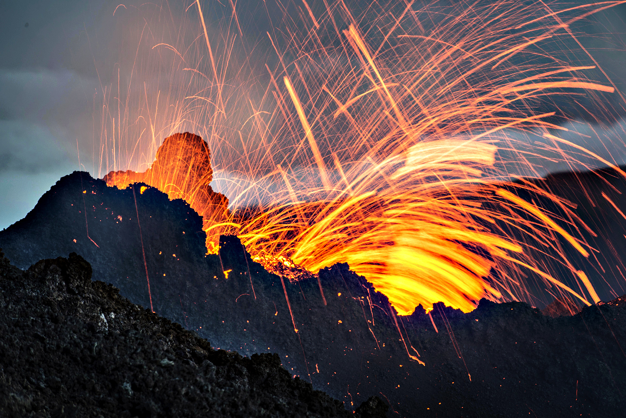 Lava erupts from the Piton de la Fournaise volcano in the French Indian Ocean island of La Reunion. This is the second eruption in the past year at Piton de la Fournaise after 3-years of quiet.