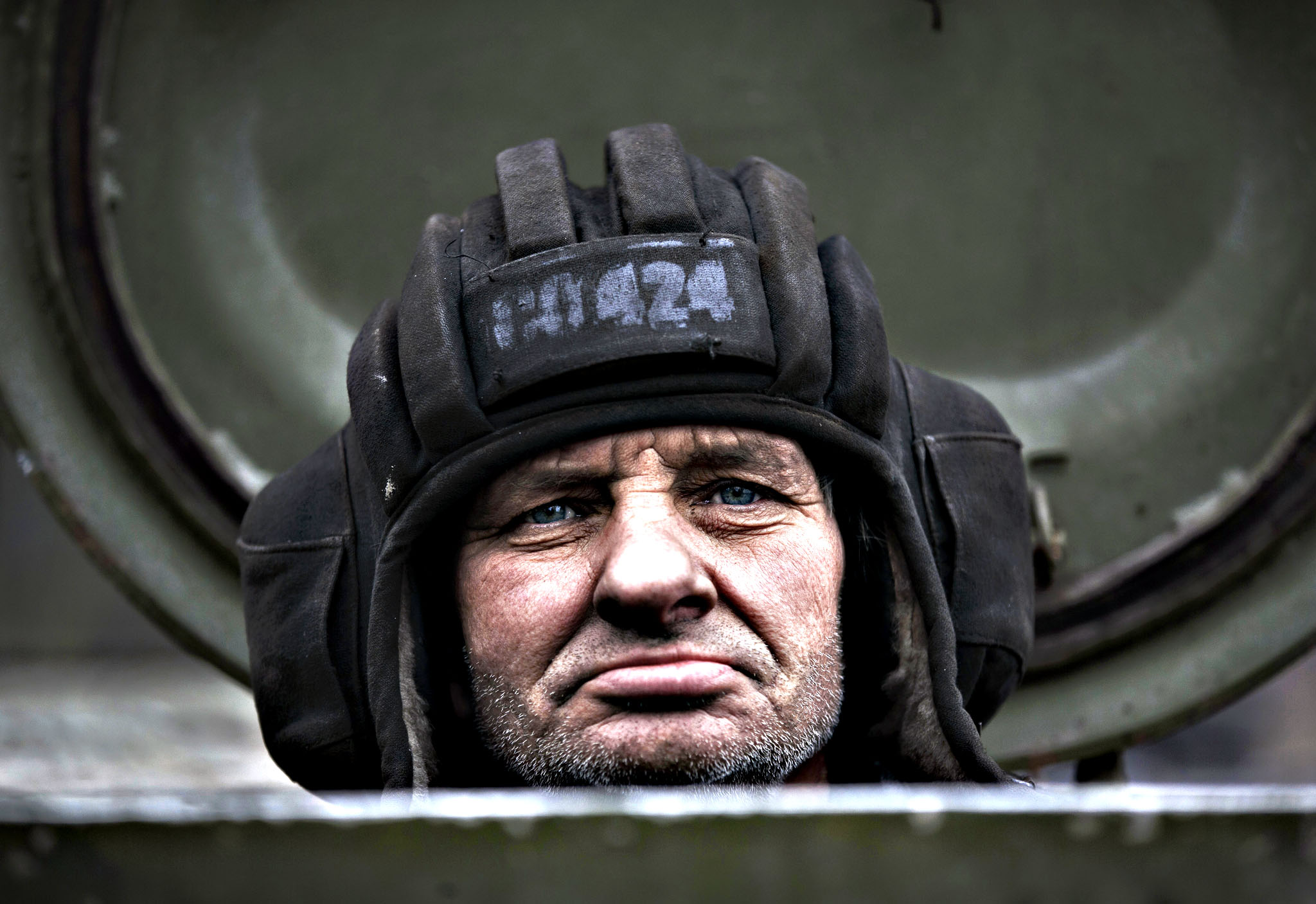 A Russia-backed separatist fighter sits in a self propelled 152 mm artillery piece, part of a unit moved away from the front lines, in Yelenovka, near Donetsk, Ukraine,Thursday, Feb. 26, 2015. Russia's foreign minister is sharply criticizing Ukraine's insistence that it won't begin pulling back heavy weapons in its fight against separatists in the east until the rebels fully observe a cease-fire.