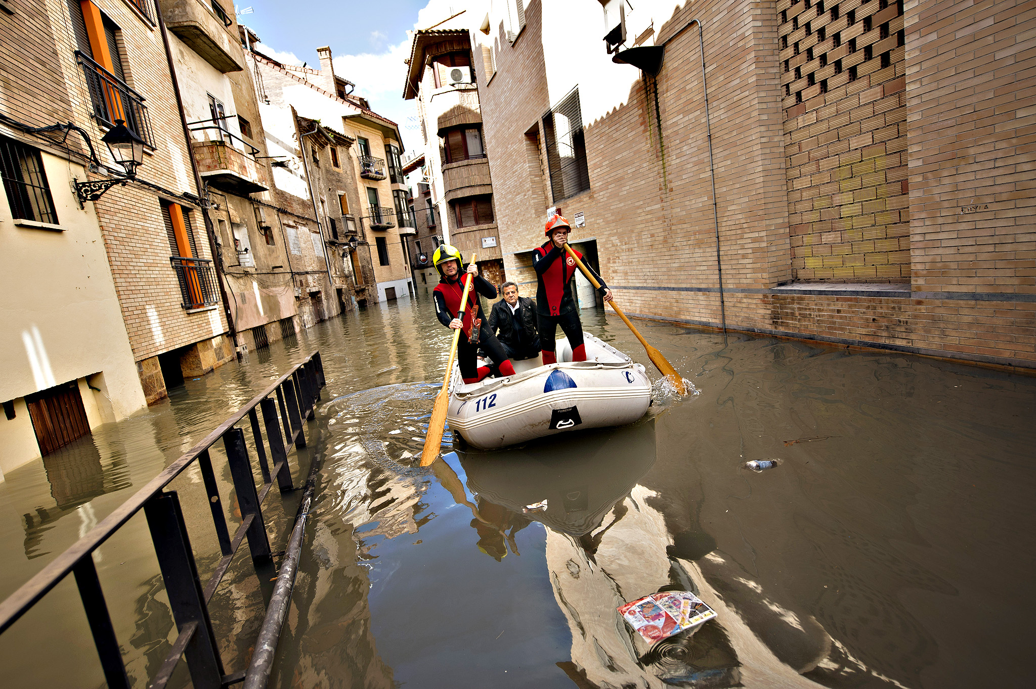A man is rescued by rescue team as the water covered the old city, in Tudela, northern Spain, Friday, Feb. 27, 2015. Heavy rain has lead to flooding in northern Spain over the past few days, especially in Navarra province.