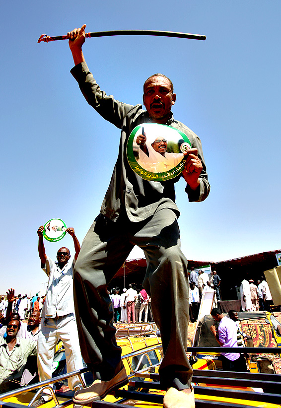Supporters of incumbent Sudanese President Omar al-Bashir (portrait) attend an electoral campaign rally in Khartoum on Tuesday, ahead of the April 13 parliamentary and presidential elections. Campaigning for Sudan's elections started in February 22 with Omar al-Bashir facing little competition for the presidency, a multi-party boycott and the opposition and press facing mounting repression.