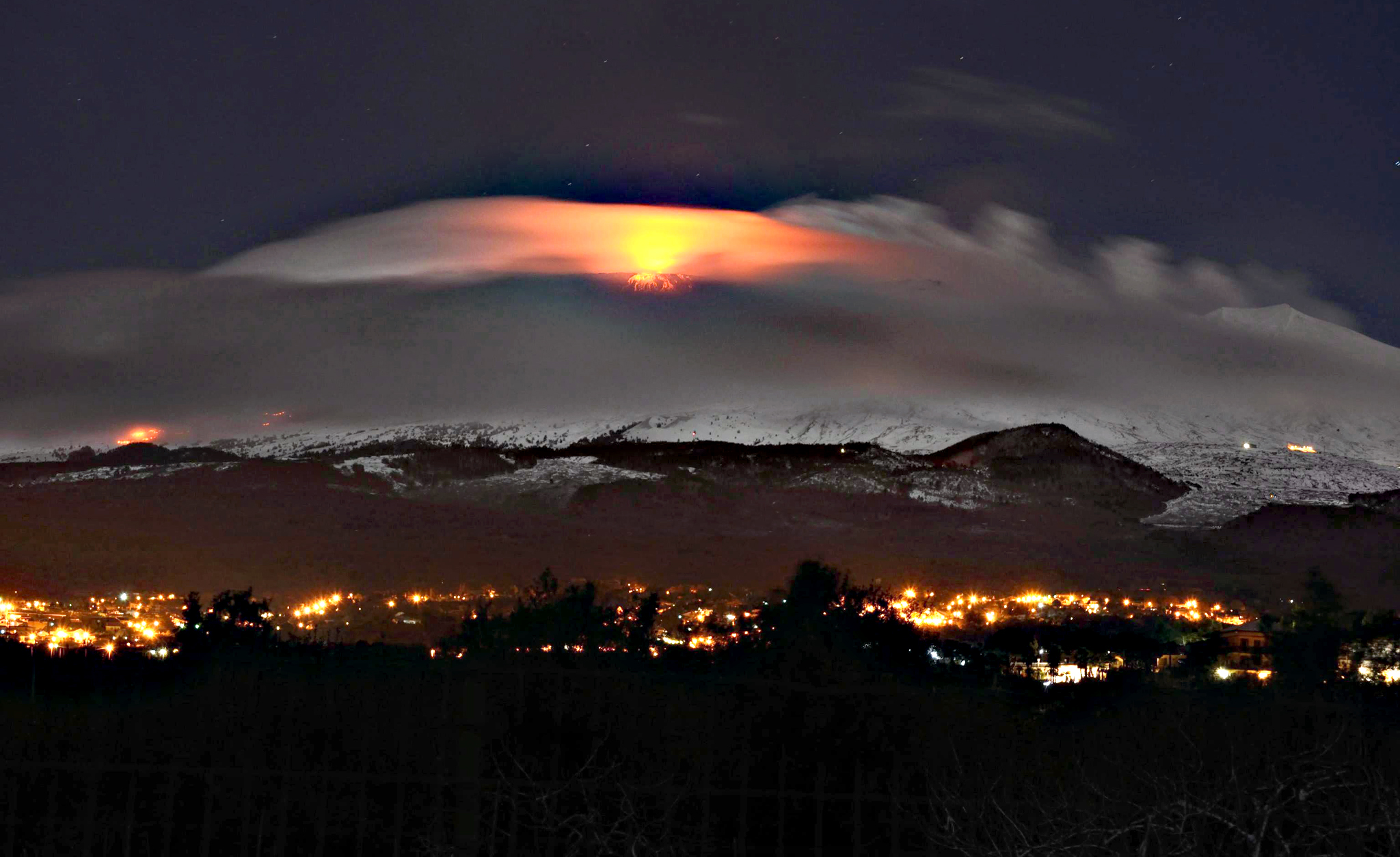A volcanic eruption illuminates the clouds around the Etna volcano, near Catania, Sicily island, southern Italy, early 02 February 2015. The eruptions are reported to have begun on 31 January 2015 at Mount Etna's new south east crater