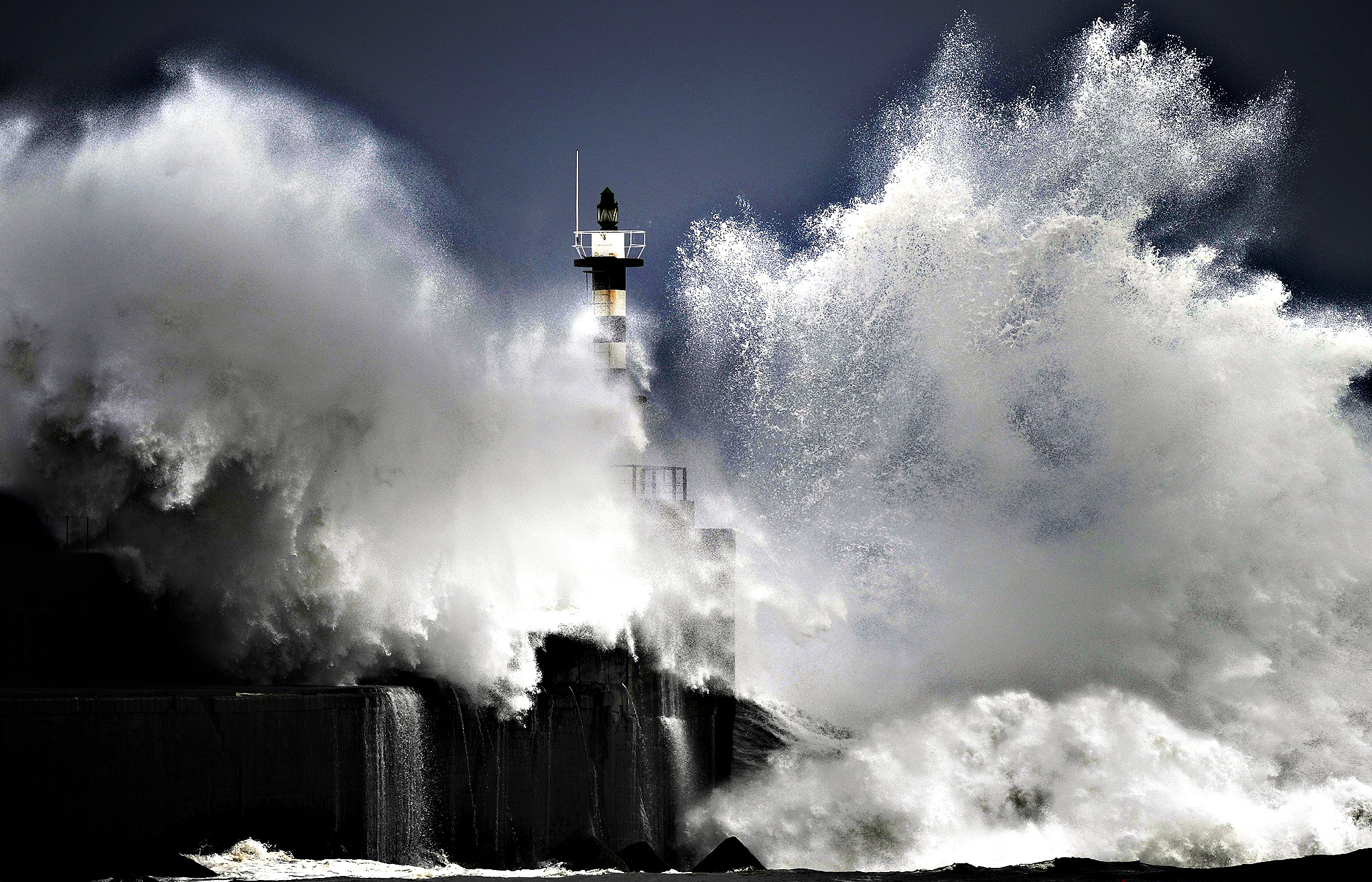 Huge waves crash on the San Esteban de Pravia seafront in the northern Spanish region of Asturias February 24, 2015.