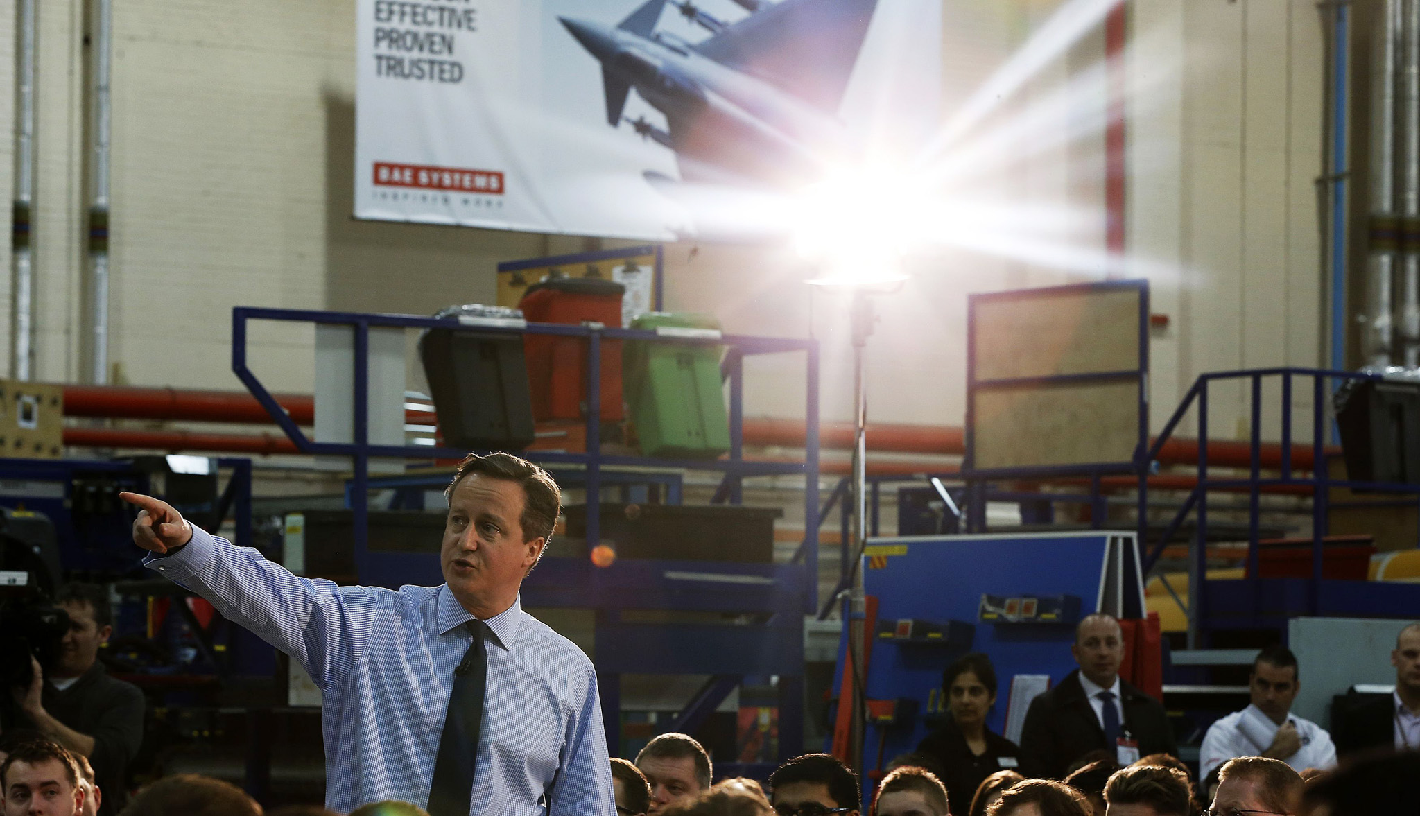 Britain's Prime Minister David Cameron speaks with a worker as he views a military aircraft during his visit to BAE Systems in Preston...Britain's Prime Minister David Cameron (L) speaks with worker Sam Barrett as he views a military aircraft during his visit to BAE Systems, in Preston, northern England March 12, 2015. REUTERS/Lynne Cameron/pool   (BRITAIN - Tags: POLITICS MILITARY BUSINESS EMPLOYMENT)