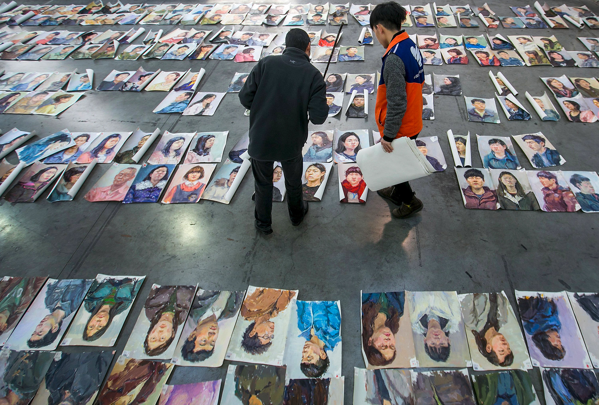 Teachers select and grade paintings done by candidates taking part in an entrance examination at China Academy of Art in Hangzhou...Teachers select and grade paintings done by candidates taking part in an entrance examination at China Academy of Art in Hangzhou, Zhejiang province, March 25, 2015. REUTERS/Chance Chan