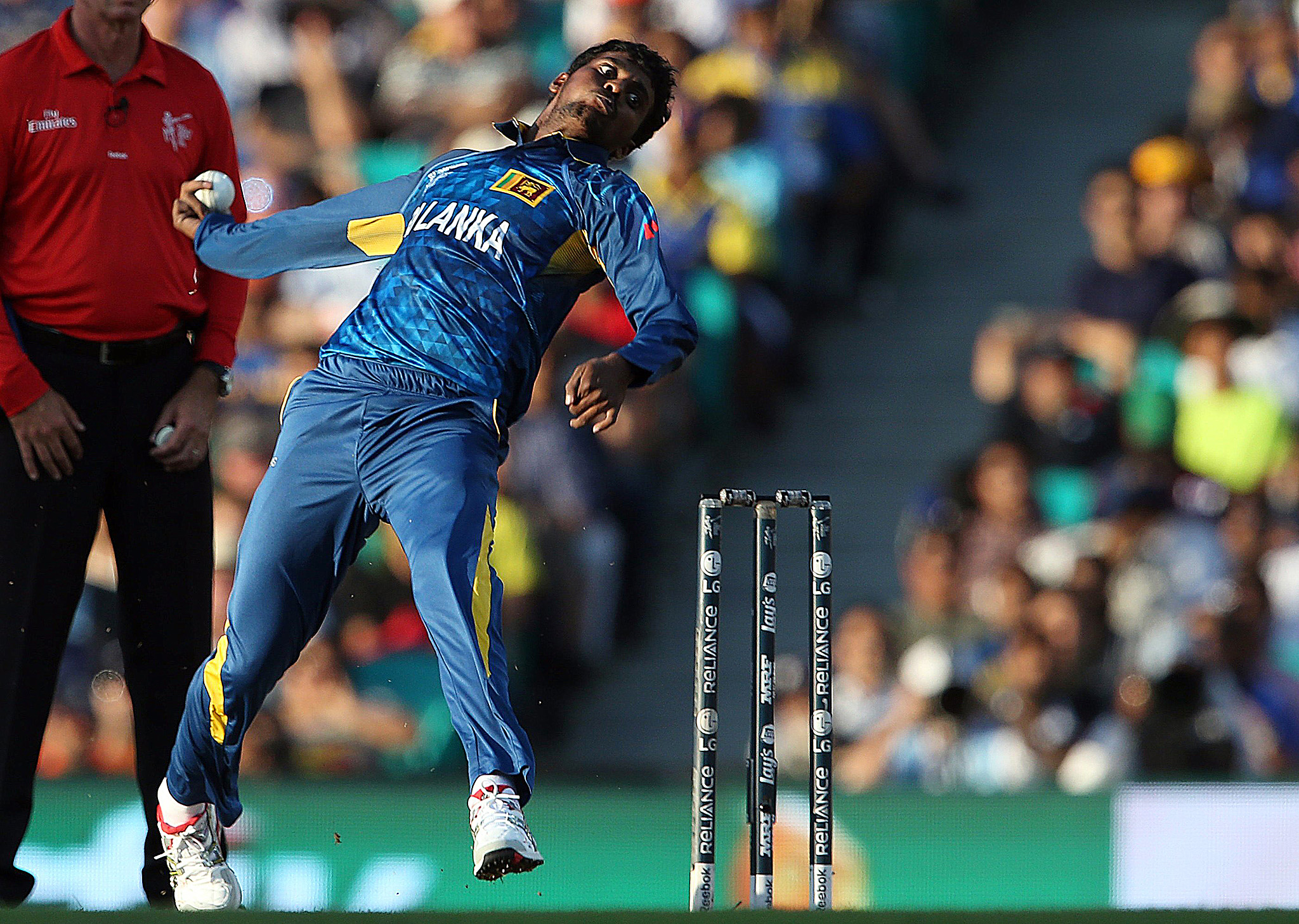 Sri Lanka's Tharindu Kaushal bowls during the Cricket World Cup quarter-final match against South Africa at the SCG...Sri Lanka's Tharindu Kaushal bowls during the Cricket World Cup quarter-final match against South Africa at the Sydney Cricket Ground (SCG) March 18, 2015.     REUTERS/Steve Christo  (AUSTRALIA - Tags: SPORT CRICKET TPX IMAGES OF THE DAY)