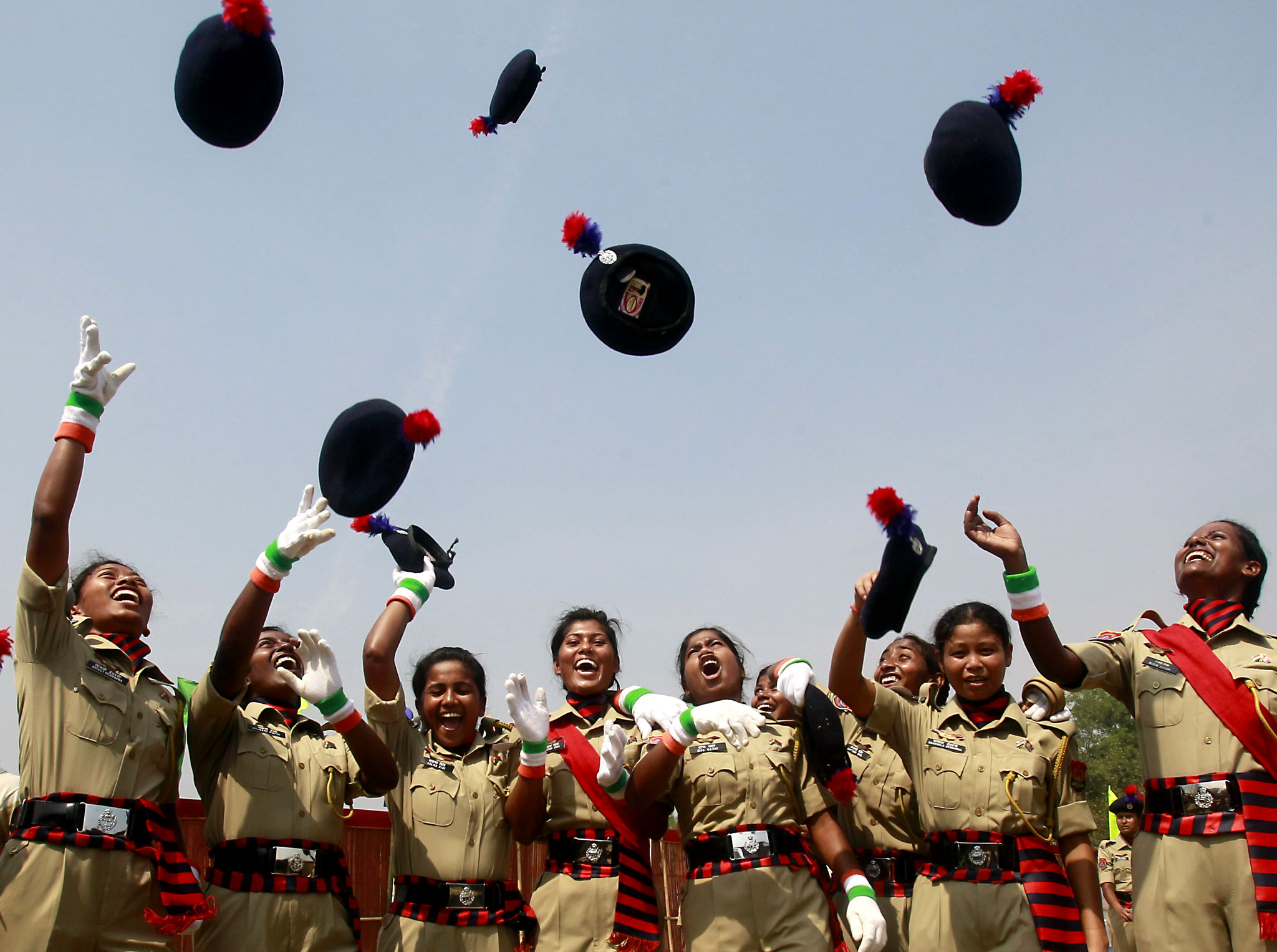 Female police recruits throw their caps in the air, as they celebrate after their passing-out parade, in the northeastern Indian city of Agar...Female police recruits throw their caps in the air, as they celebrate after their passing-out parade, in the northeastern Indian city of Agartala, March 2, 2015. REUTERS/Jayanta Dey (INDIA - Tags: MILITARY)