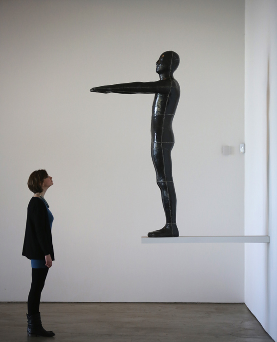Exhibition Of Forty Artists Work Opens At The Yorkshire Sculpture Park...BARNSLEY, ENGLAND - MARCH 27:  A gallery staff member views Untitled (Diving Figure) by Antony Gormley, one of the works on display at in Yorkshire Sculpture Parks Longside Gallery as part of the 'Making It: Sculpture in Britain 1977-1986' exhibition on March 27, 2015 in Barnsley, England.  Yorkshire Sculpture Parks latest exhibition brings together the work of over 40 influential artists gathered mainly from the Arts Council Collection. 'Making It: Sculpture in Britain 1977-1986'  is the first exhibition to survey the era in British sculpture when a talented UK generation of artists began to receive international attention. The exhibition at the Longdale Gallery is open from 1 April - 21 June 2015.  (Photo by Christopher Furlong/Getty Images)