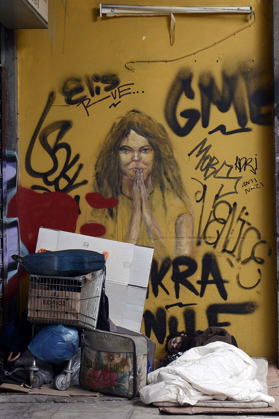 A homeless man sleeps under a graffiti i...A homeless man sleeps under a graffiti in central Athens on March 12, 2015. Greece and its international creditors prepare to kick off fiscal talks in Athens on March 12, 2015, breaking a six-week impasse on how to extend the country's huge EU-IMF bailout and restore the flow of loans to avert a state cash shortage. AFP PHOTO/ LOUISA GOULIAMAKILOUISA GOULIAMAKI/AFP/Getty Images