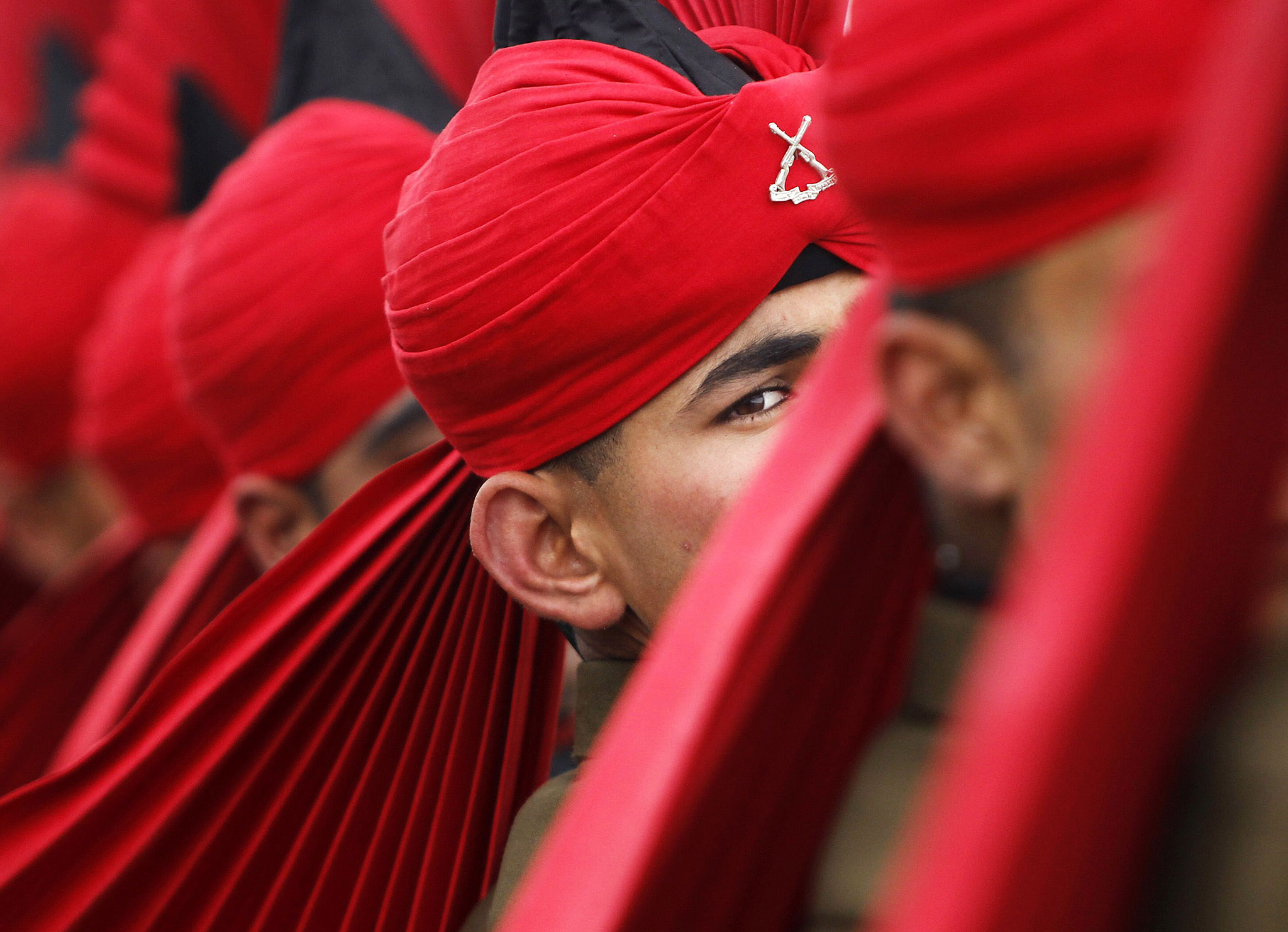 An Indian army recruit wearing ceremonial uniform looks during passing out parade at garrison in Rangreth on outskirts of Srinagar...An Indian army recruit wearing his ceremonial uniform looks on as he marches during their passing out parade at a garrison in Rangreth on the outskirts of Srinagar March 4, 2015. A total of 179 youths from various religious backgrounds were formally inducted into the Indian army's Jammu and Kashmiri Light Infantry Regiment (JKLIR) after their 49 week training, an army official said.  REUTERS/Danish Ismail (INDIAN-ADMINISTERED KASHMIR - Tags: MILITARY TPX IMAGES OF THE DAY)