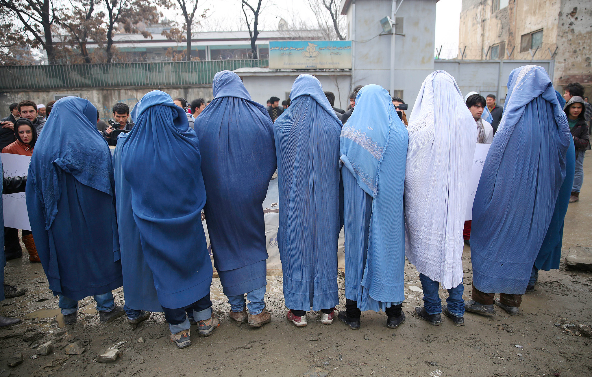 Male civil society members wear burqas to protest violence against women, ahead of International Women's Day, in Kabul, Afghanistan, Thursday, March 5, 2015. (AP Photo/Massoud Hossaini)