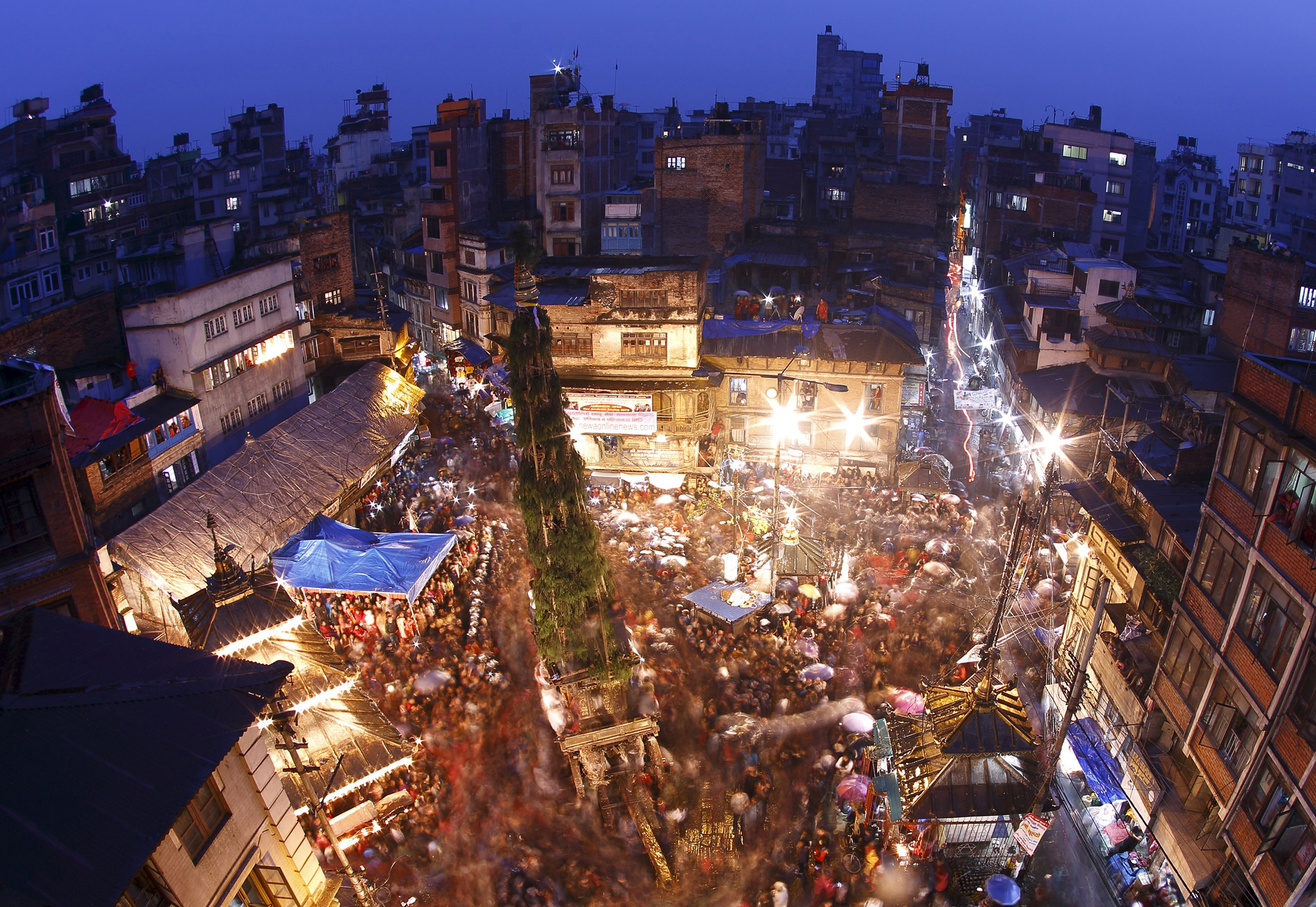 Devotees gather around the chariot of Seto Machindranath during the Seto Machindranath chariot festival at Ashon in Kathmandu...Devotees gather around the chariot of Seto Machindranath (C) during the Seto Machindranath chariot festival at Ashon in Kathmandu March 27, 2015. The Seto Machindranath chariot festival is celebrated to pray for rainfall and good harvest for the upcoming year. REUTERS/Navesh Chitrakar      TPX IMAGES OF THE DAY           TPX IMAGES OF THE DAY