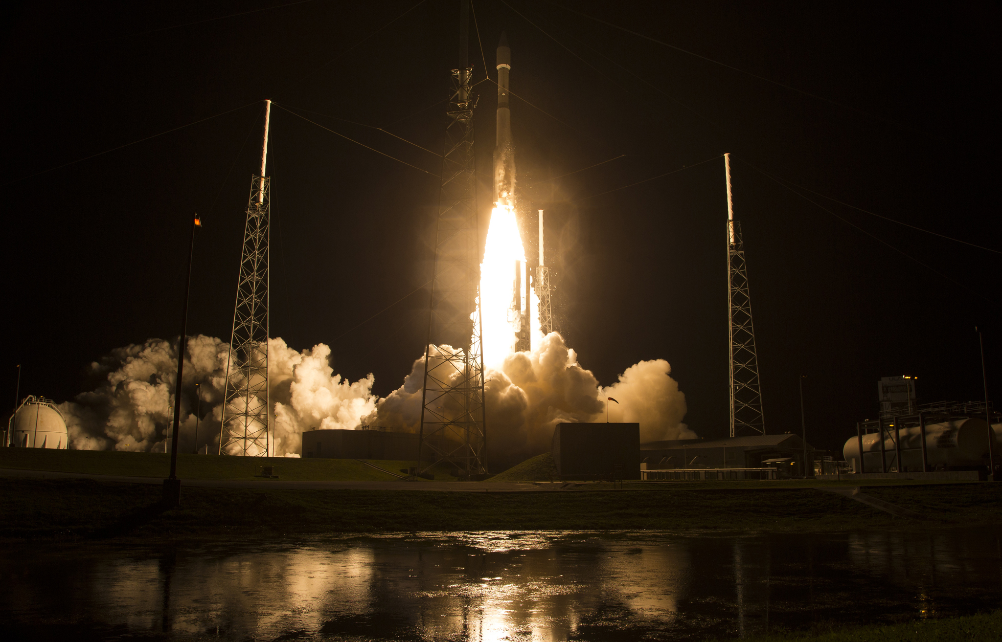 the United Launch Alliance Atlas V rocket with NASA's Magnetospheric Multiscale (MMS) spacecraft onboard launches from the Air Force Station Space Launch Complex 41 March 12, 2015 in Cape Canaveral, Florida. NASA's MMS mission will study how magnetic fields around Earth connect and disconnect, explosively releasing energy via a process known as magnetic reconnection. MMS consists of four identical spacecraft that work together to provide the first three-dimensional view of this fundamental process, which occurs throughout the universe.