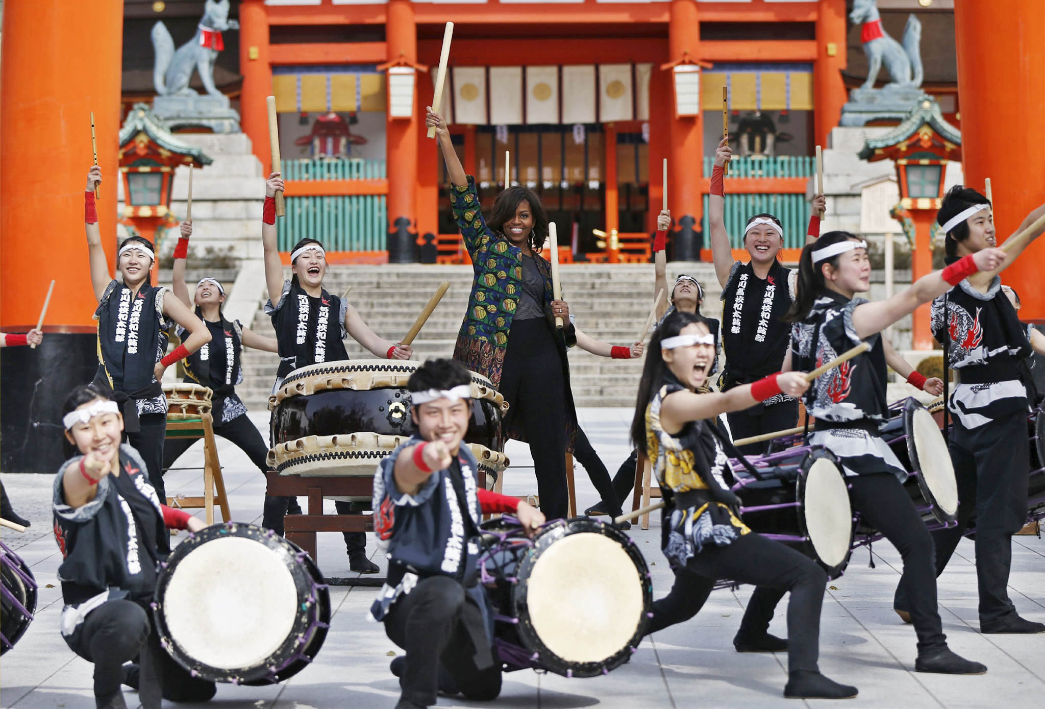 "U.S. first lady Michelle Obama beats a Japanese traditional taiko drum with members from Akutagawa High School Taiko Club in front of the main gate, as she visits Fushimi Inari Shinto Shrine in Kyoto, western Japan March 20, 2015.  REUTERS/Issei Kato            TPX IMAGES OF THE DAY REUTERS NEWS PICTURES HAS NOW MADE IT EASIER TO FIND THE BEST PHOTOS FROM THE MOST IMPORTANT STORIES AND TOP STANDALONES EACH DAY. Search for ""TPX"" in the IPTC Supplemental Category field or ""IMAGES OF THE DAY"" in the Caption field and you will find a selection of 80-100 of our daily Top Pictures."