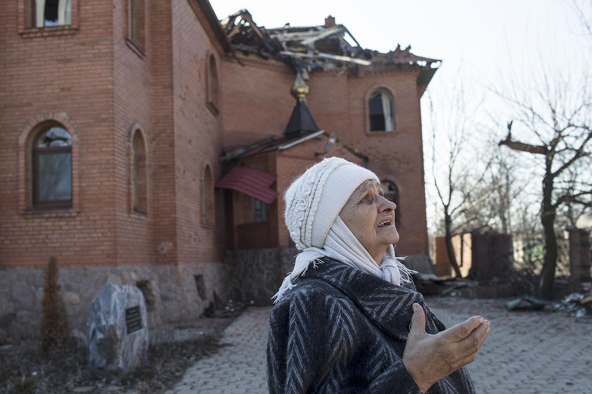 A woman reacts as she looks at a damaged church in Donetsk's Oktyabrski district...A woman reacts as she looks at a damaged church in Donetsk's Oktyabrski district, March 9, 2015. REUTERS/Marko Djurica (UKRAINE - Tags: POLITICS CIVIL UNREST CONFLICT)A woman reacts as she looks at a damaged church in Donetsk's Oktyabrski district...A woman reacts as she looks at a damaged church in Donetsk's Oktyabrski district, March 9, 2015. REUTERS/Marko Djurica (UKRAINE - Tags: POLITICS CIVIL UNREST CONFLICT)