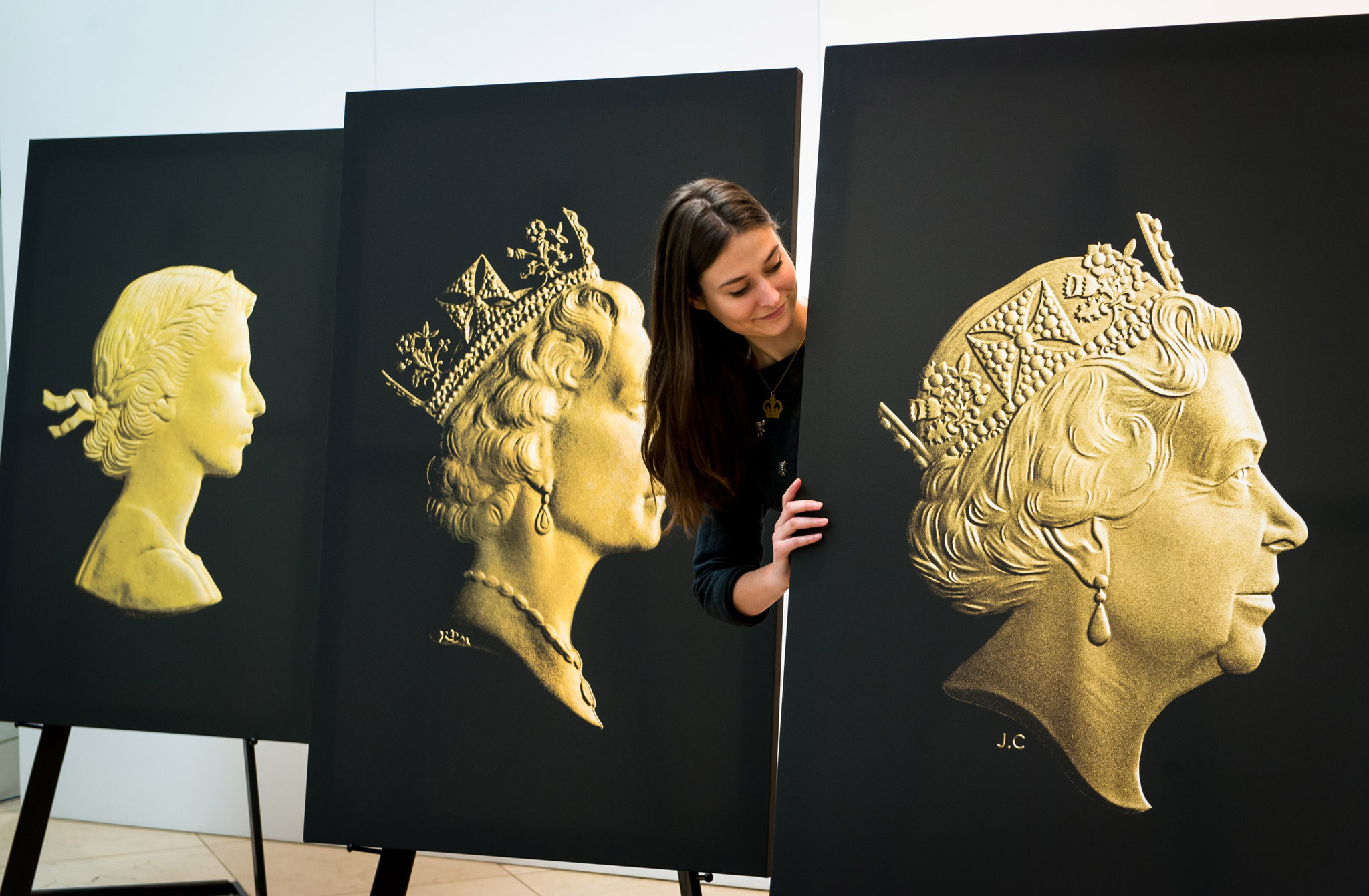 The Royal Mint unveil the new coinage portrait of the Queen at the National Portrait Gallery...The Royal Mint unveil the new coinage portrait of the Queen at the National Portrait Gallery, London on Monday 2nd March 2015 This picture: Flora Laven-Morris looks at the new portrait (right) PR Handout  For further information or a full release please contact Hope & Glory PR at royalmint@hopeandglorypr.com or call Sasha / Corinna on 07785 628 917 / 07532 171 496 Copyright: © Mikael Buck +44 (0) 782 820 1042 http://www.mikaelbuck.com