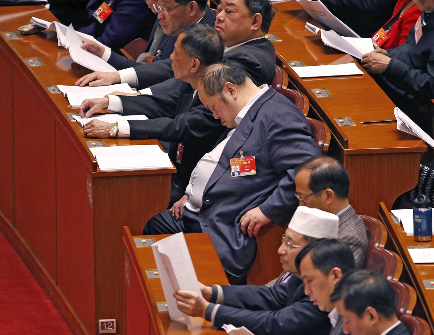 A delegate takes a nap during the third plenary meeting of Chinese People's Political Consultative Conference (CPPCC) at the Great Hall of the People in Beijing
