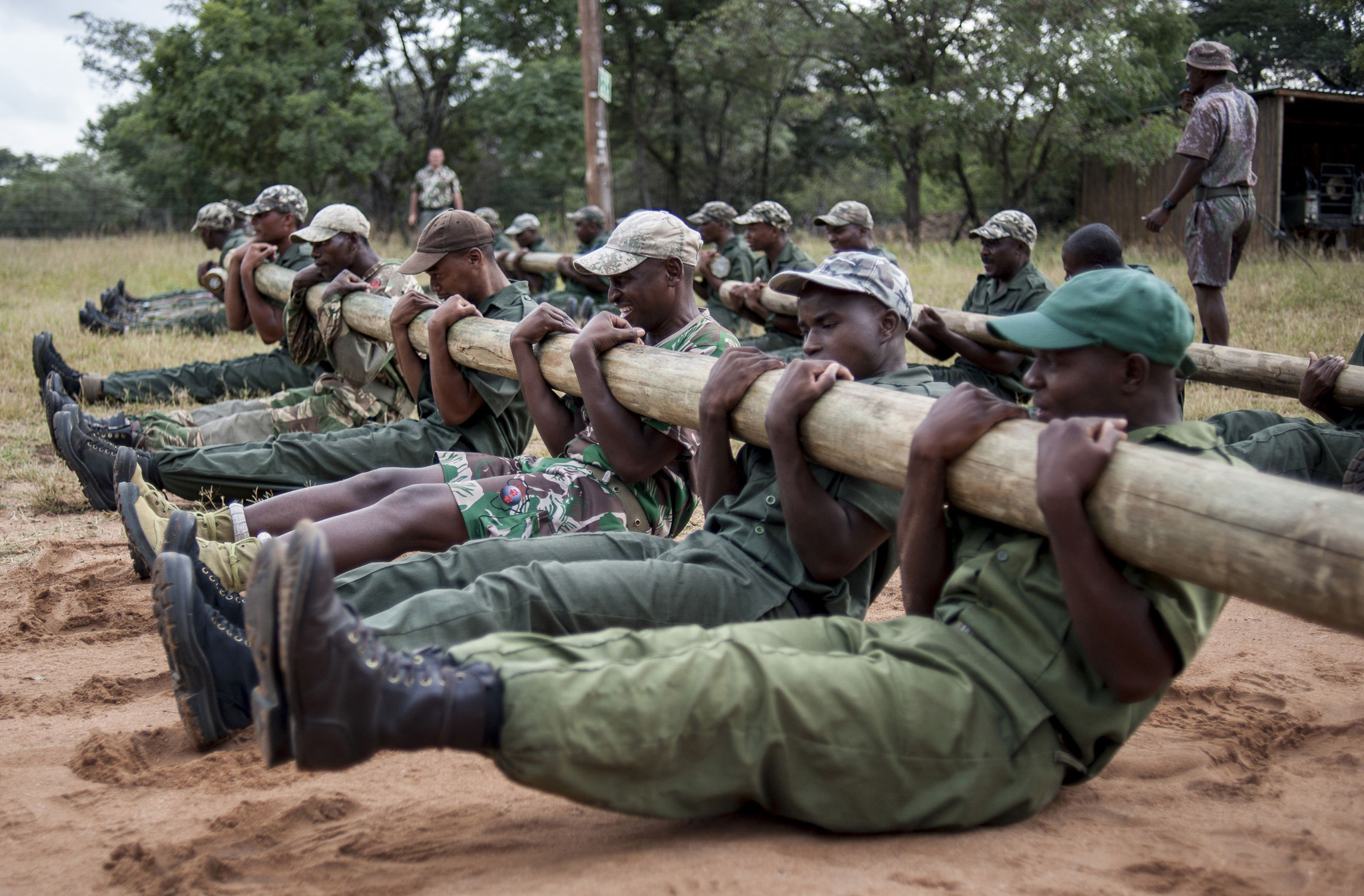 """Qualified anti-poaching rangers and new recruits train during an """"Op-Fok"""" training session at the Nkwe Tactical Training Academy in Vaalwater in the Limpopo. South Africa."""