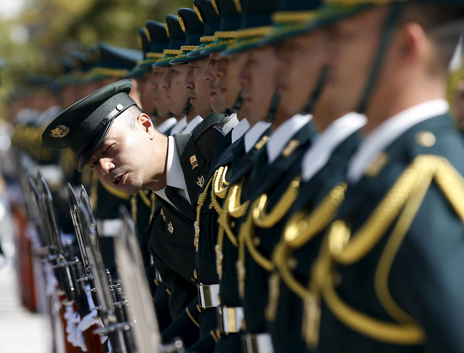 Members of Japan's Self-Defence Force's honour guard prepare for a ceremony for U.S. Army General Dempsey, chairman of the Joint Chiefs of Staff, at the Defense Ministry in Tokyo