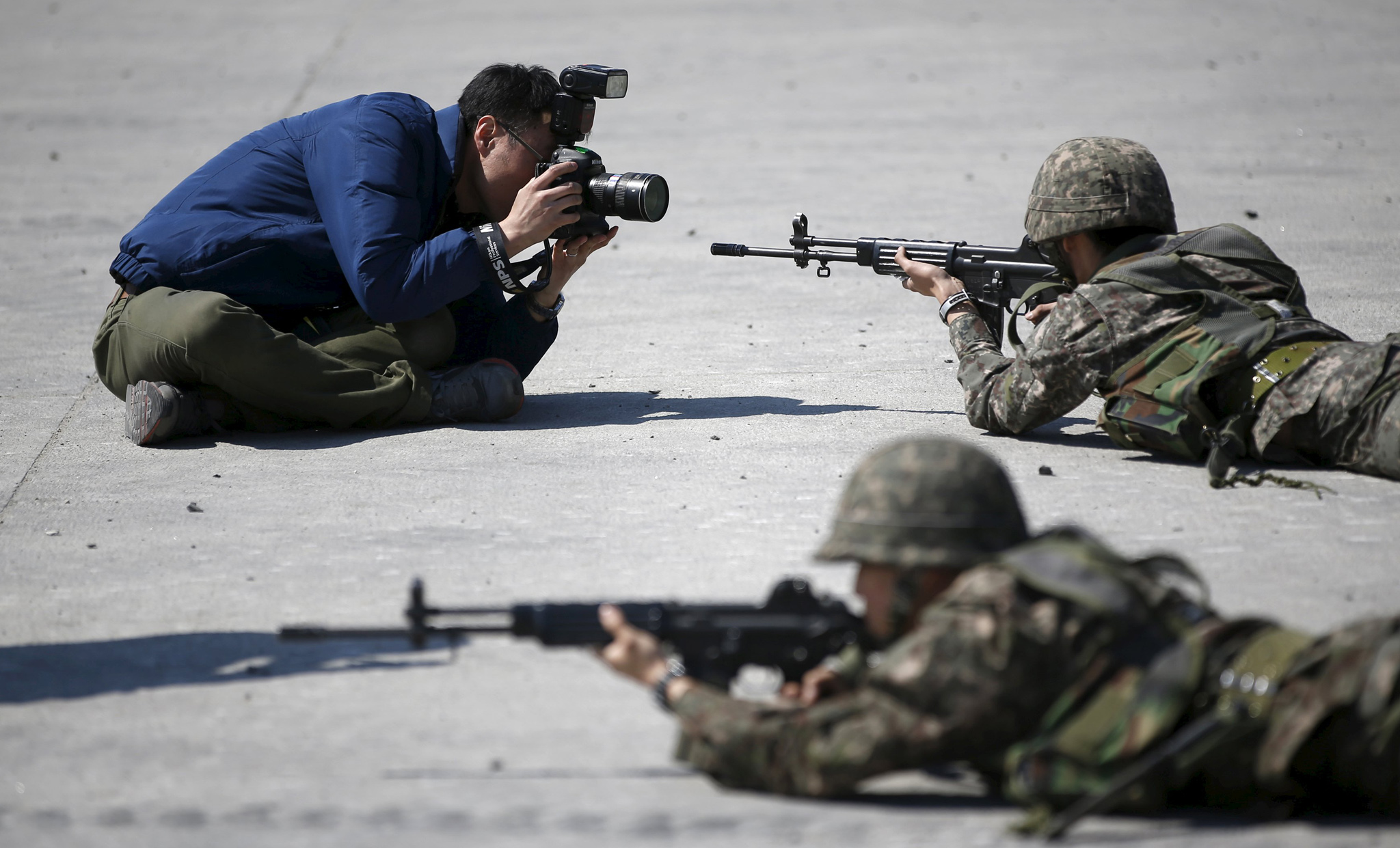 A photographer takes pictures of South Korean army soldiers taking part in a U.S.-South Korea joint live-fire military exercise at a training field in Pocheon, south of the demilitarized zone.