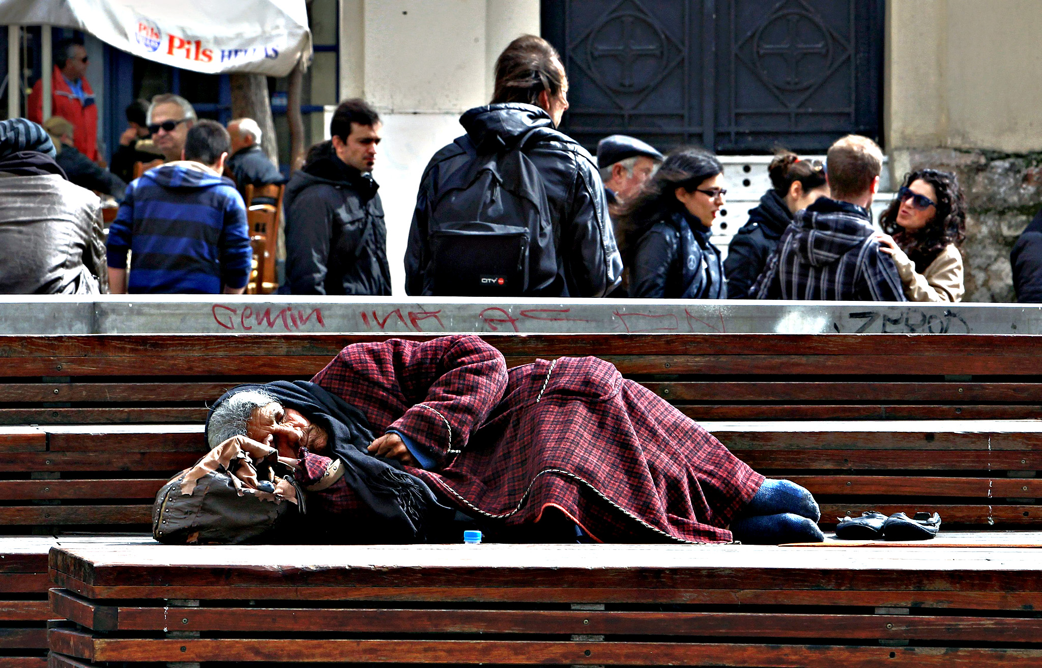 An elderly homeless woman sleeps on a bench in the touristic area of Monastiraki in central Athens, Greece, 06 March 2015. The eurozone economy showed signs of recovery in the last three months of 2014, with growth of 0.3 per cent compared to the previous quarter, the European Union's statistics office Eurostat said 06 March confirming preliminary estimates. Bailout recipients Cyprus and Greece saw their economies shrink by 0.7 per cent and 0.4 per cent respectively.