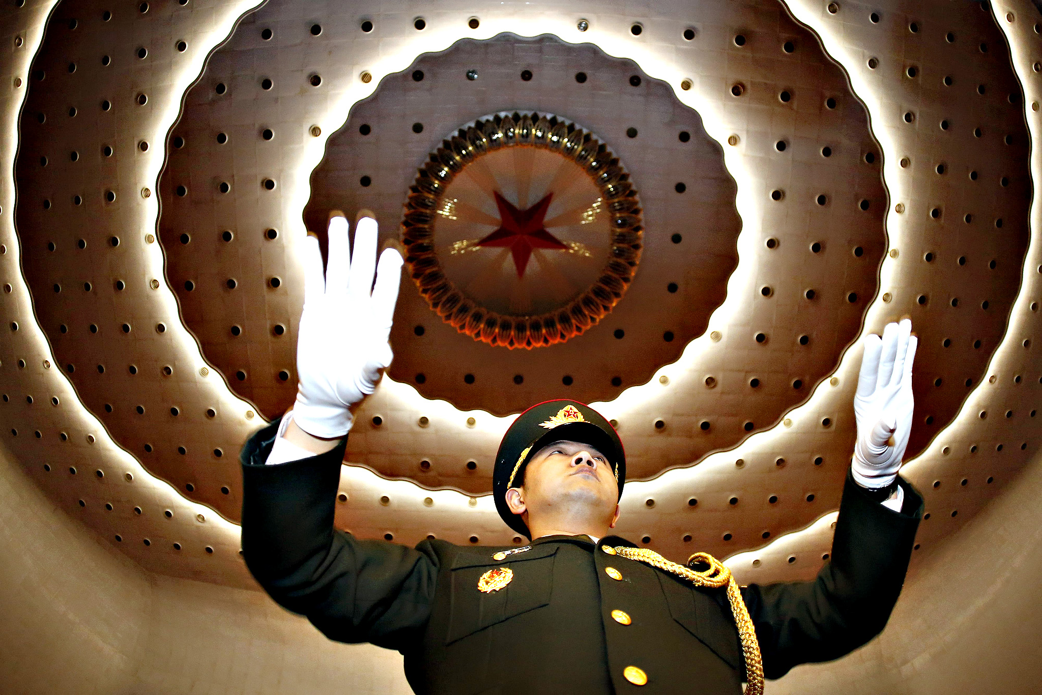 A military band conductor practices during rehearsal ahead the opening session of the third plenum of the 12th National People's Congress (NPC) at the Great Hall of the People in Beijing, China, 05 March 2015. The NPC has over 3,000 delegates and is the world's largest parliament or legislative assembly though its function is largely as a formal seal of approval for the policies fixed by the leaders of the Chinese Communist Party.
