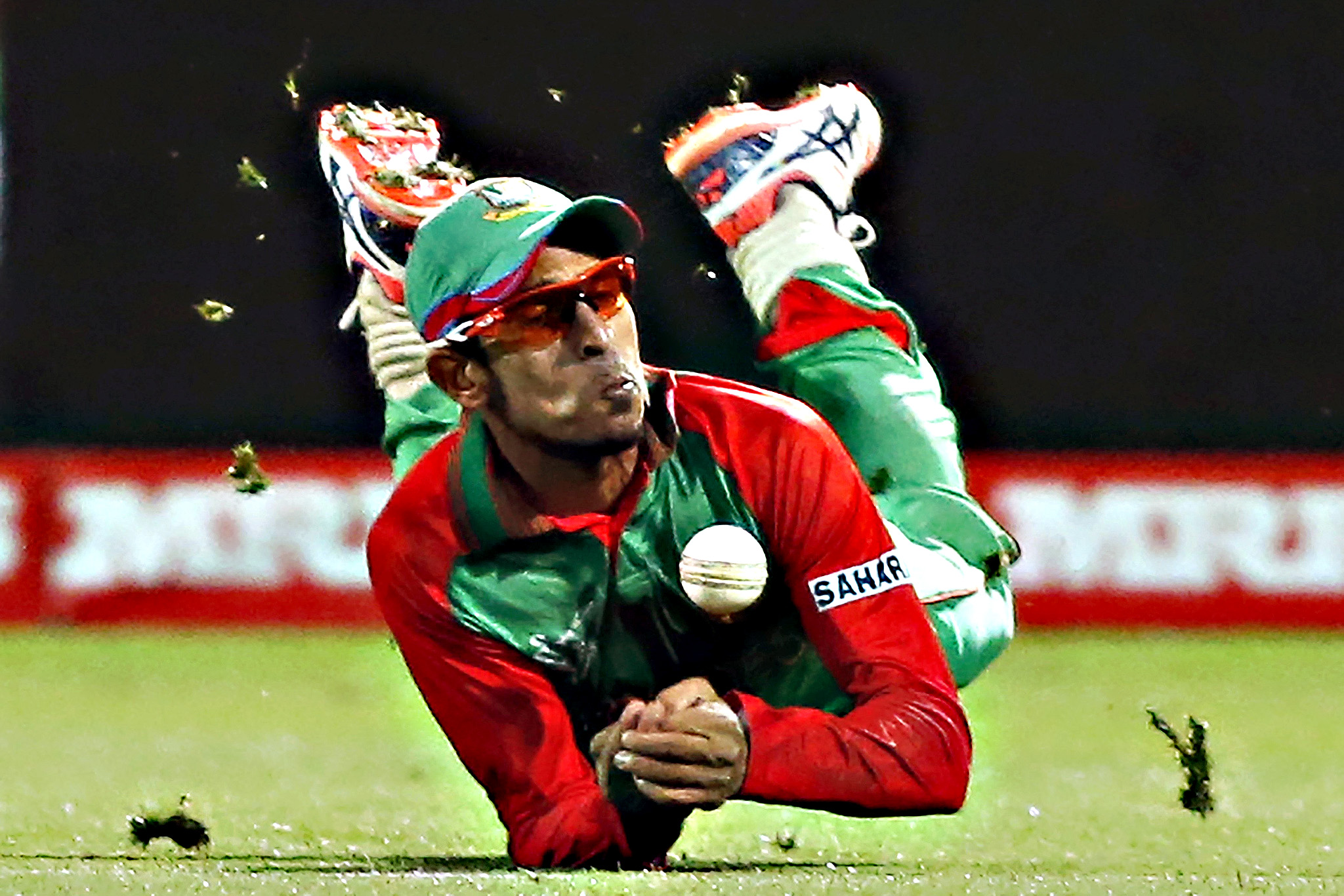 Bangladesh's Nasir Hossain drops a catch from New Zealand's Cory Anderson during their Cricket World Cup match in Hamilton, Friday
