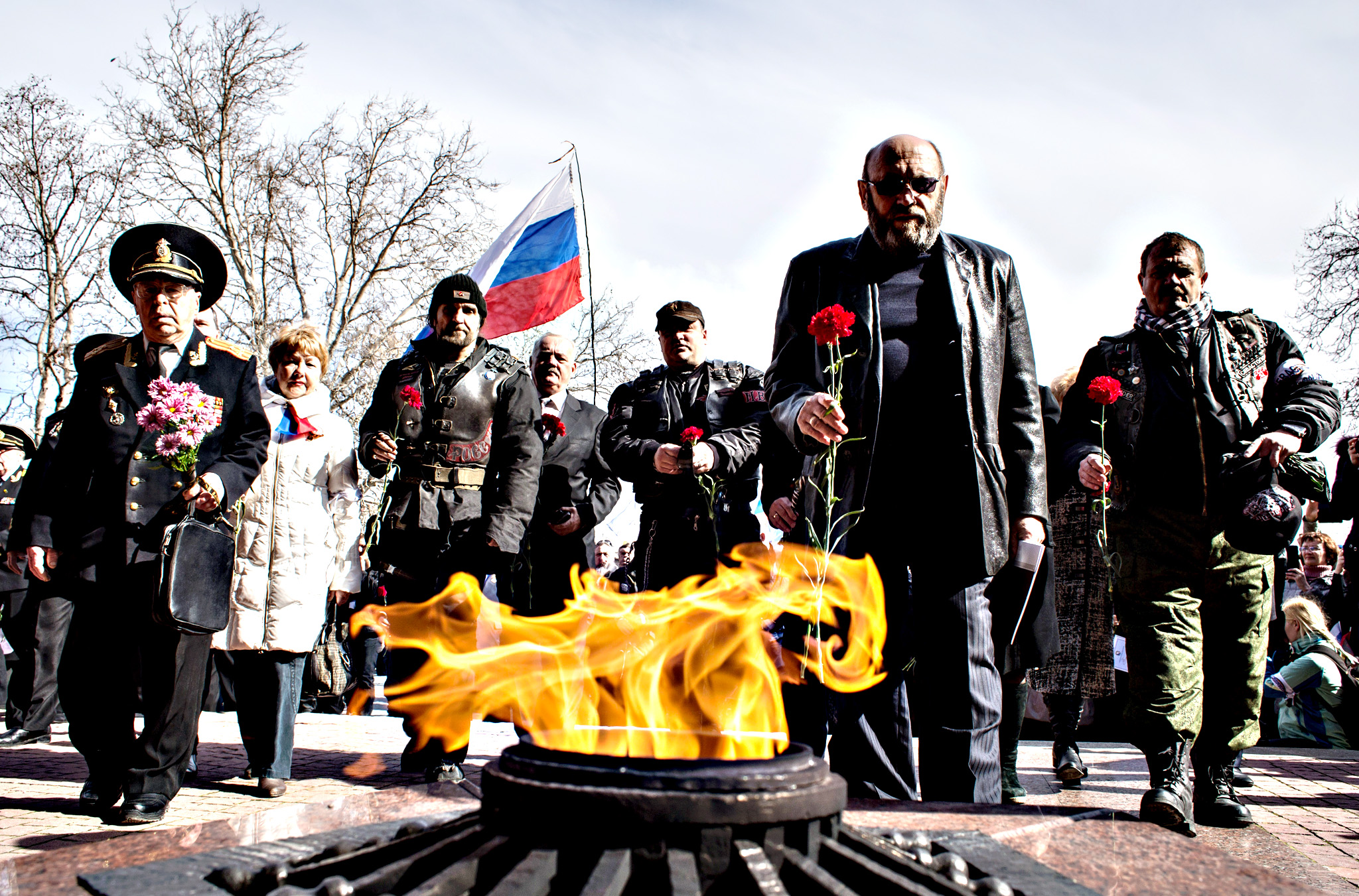 People bring flowers to the eternal flame on the memorial of the heroic defense of Sevastopol (1941-1942) as Crimeans celebrate the first anniversary of the referendum on Monday in Sevastopol, Crimea . Today marks the first anniversary of the referendum which resulted in the annexation of the territory by Russia