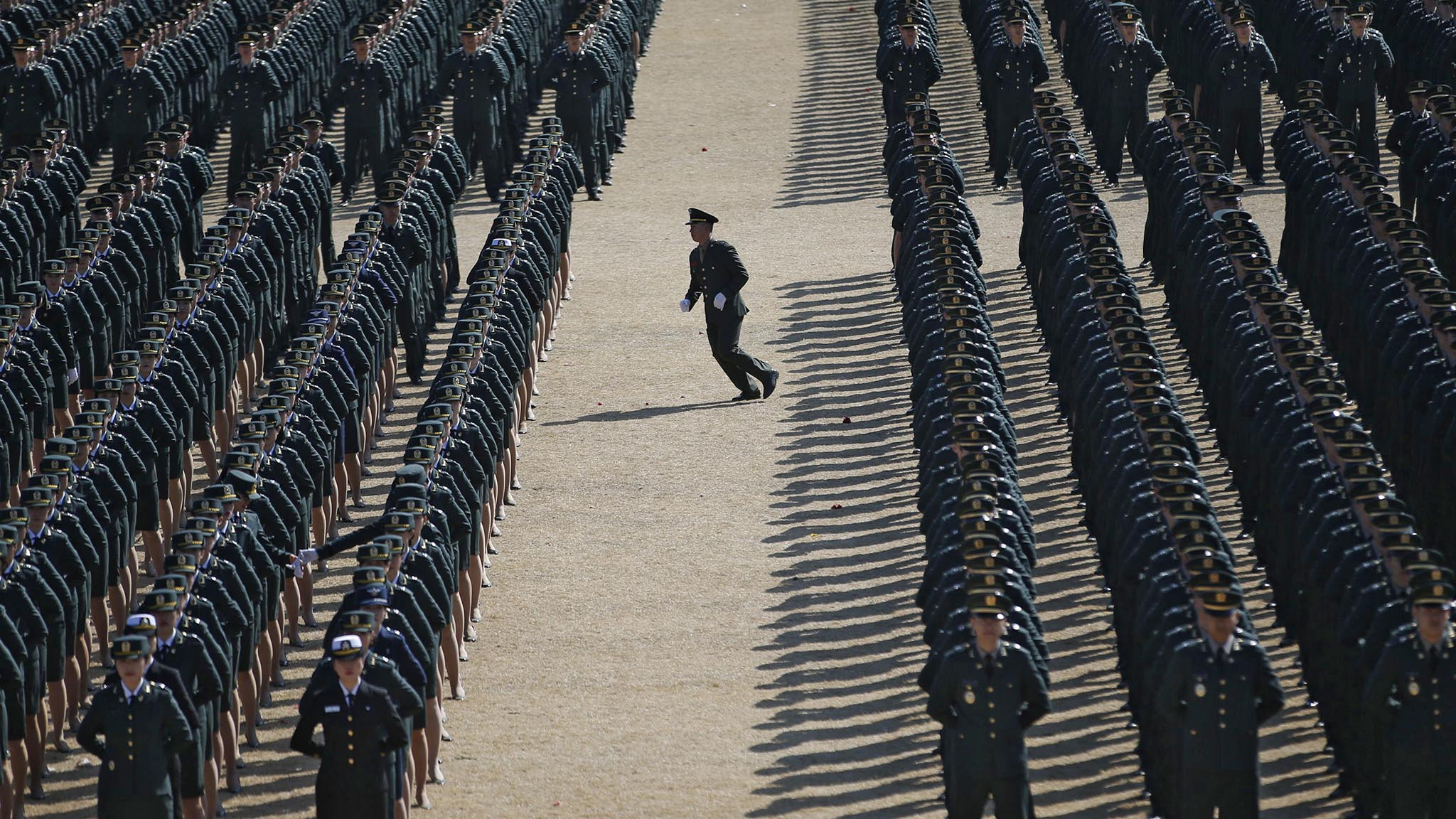 A new South Korean military officer runs into an echelon as they attend a joint commissioning ceremony for 6,478 new officers from the Army, Navy, Air Force and Marines at the military headquarters in Gyeryong