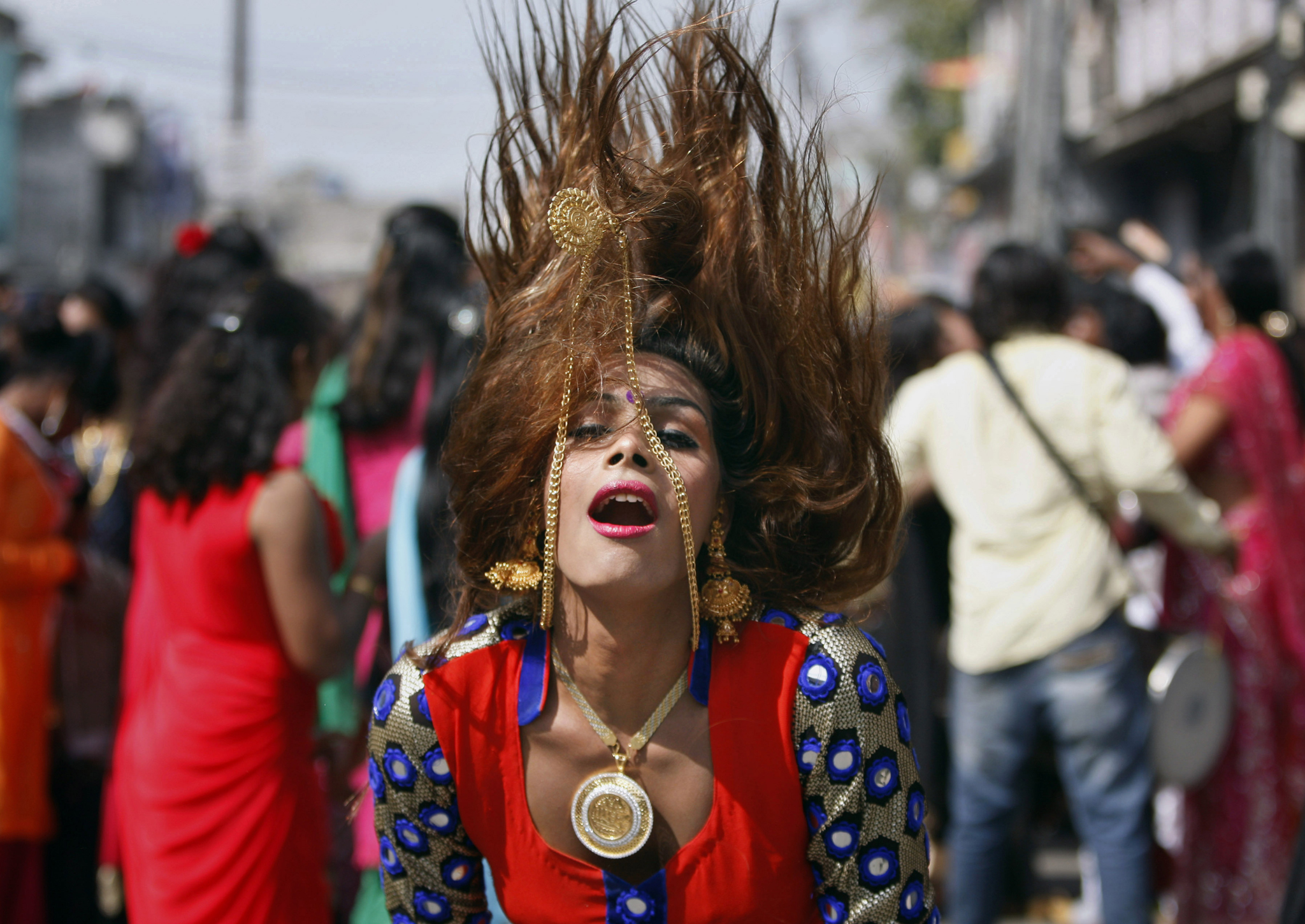 A eunuch dances during a rally to mark the congregation of thousands of eunuchs from different parts of India, in Jammu, India,