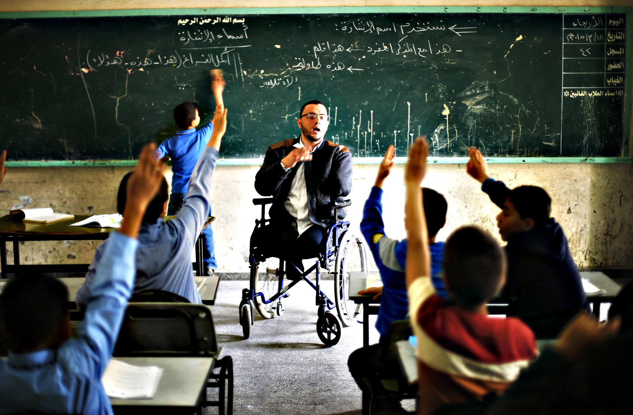 Wheelchair-bound Palestinian student teacher Ahmed al-Sawaferi, 25, who said that he lost his both legs and his left arm in an Israeli air strike in 2008, gives a class at an elementary school in Gaza City...Wheelchair-bound Palestinian student teacher Ahmed al-Sawaferi, 25, who said that he lost his both legs and his left arm in an Israeli air strike in 2008, gives a class at an elementary school in Gaza City March 18, 2015. Al-Sawaferi, a father for two children, is due to hold a B.A in Islamic studies after finishing his last university semester in June this year