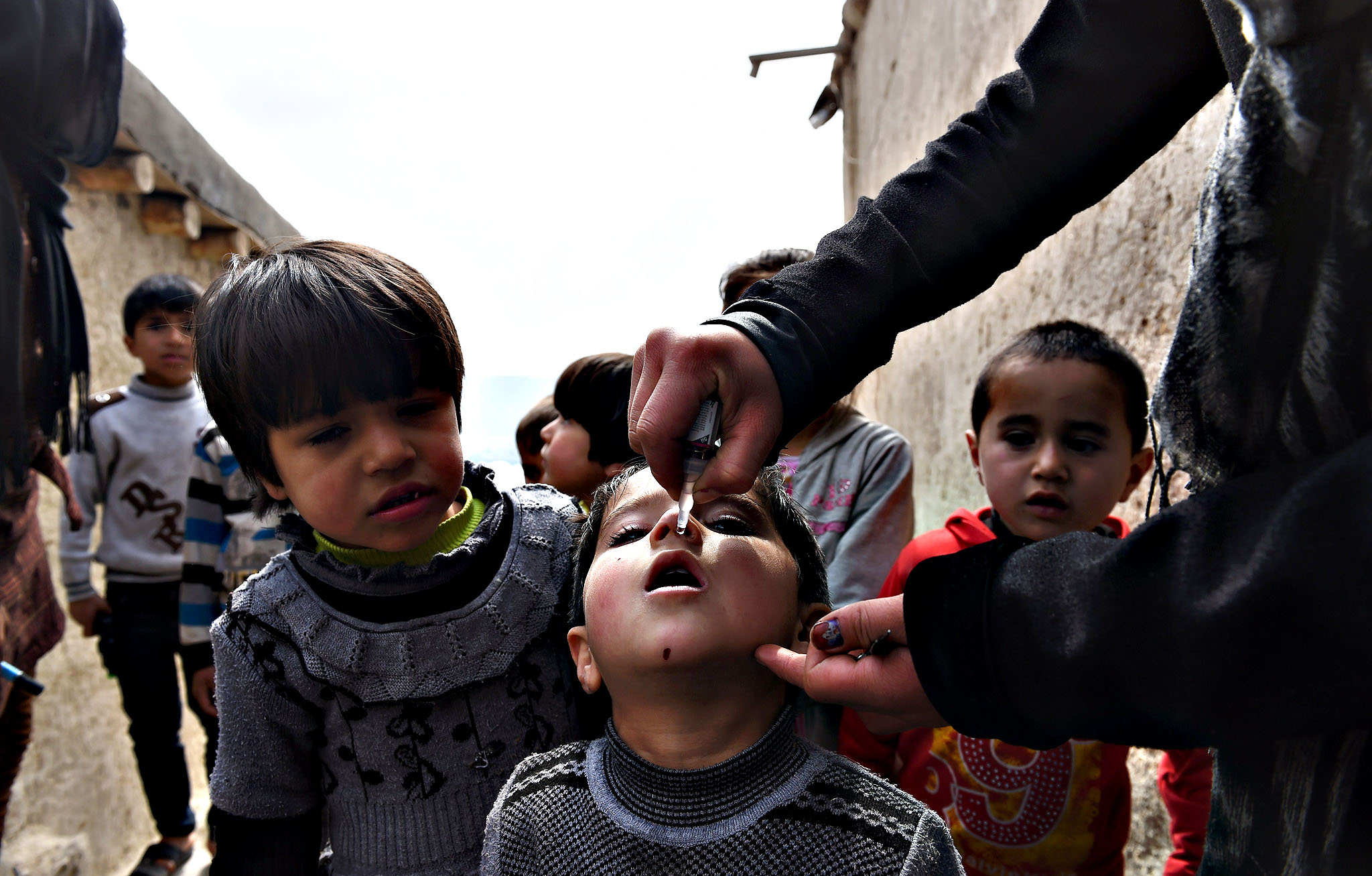 An Afghan health worker administers polio vaccine drops to a child on the second day of a vaccination campaign in Kabul on March 16, 2015. Nearly nine million children throughout Afghanistan will be immunized during a three-day national polio immunization drive launched on March 15.The immunization campaign comes shortly after Afghanistan reported its first case of polio virus for 2015, in Helmand, in the Southern Region. Afghanistan and Pakistan are the only two countries in the world to have reported cases of the crippling polio virus in the past eight months and it is increasingly likely that these are the last two countries on Earth with active polio transmission