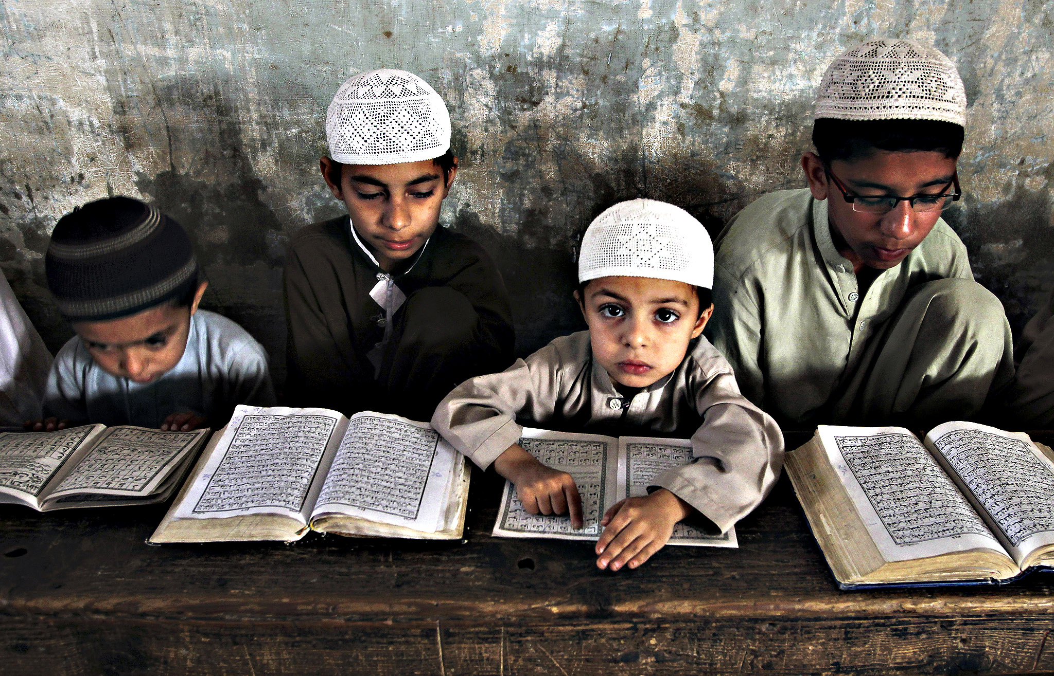 Pakistani Muslim students attend a religious madrassa, or school, to learn the Quran, in Karachi, Pakistan, Wednesday, March 4, 2015. Religious schools in Pakistan, most of them in mosques, are the only source of education for thousands of children.