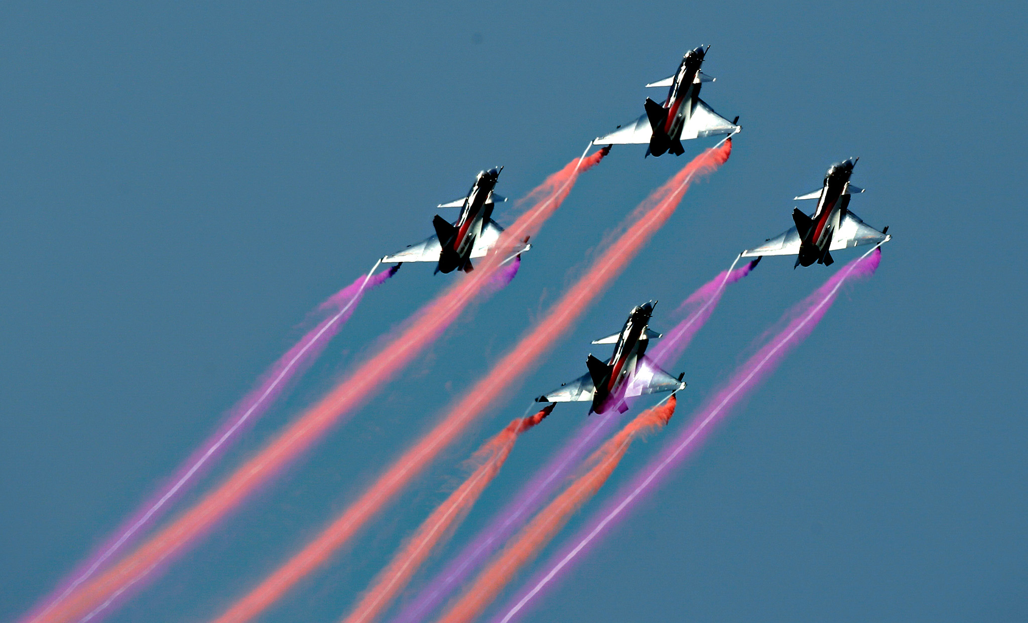 The People's Liberation Army's Air Force Air Demonstration Team, China's best-known aerobatic team, performs at Langkawi International Maritime and Aerospace Exhibition in Langkawi, Malaysia, on Thursday